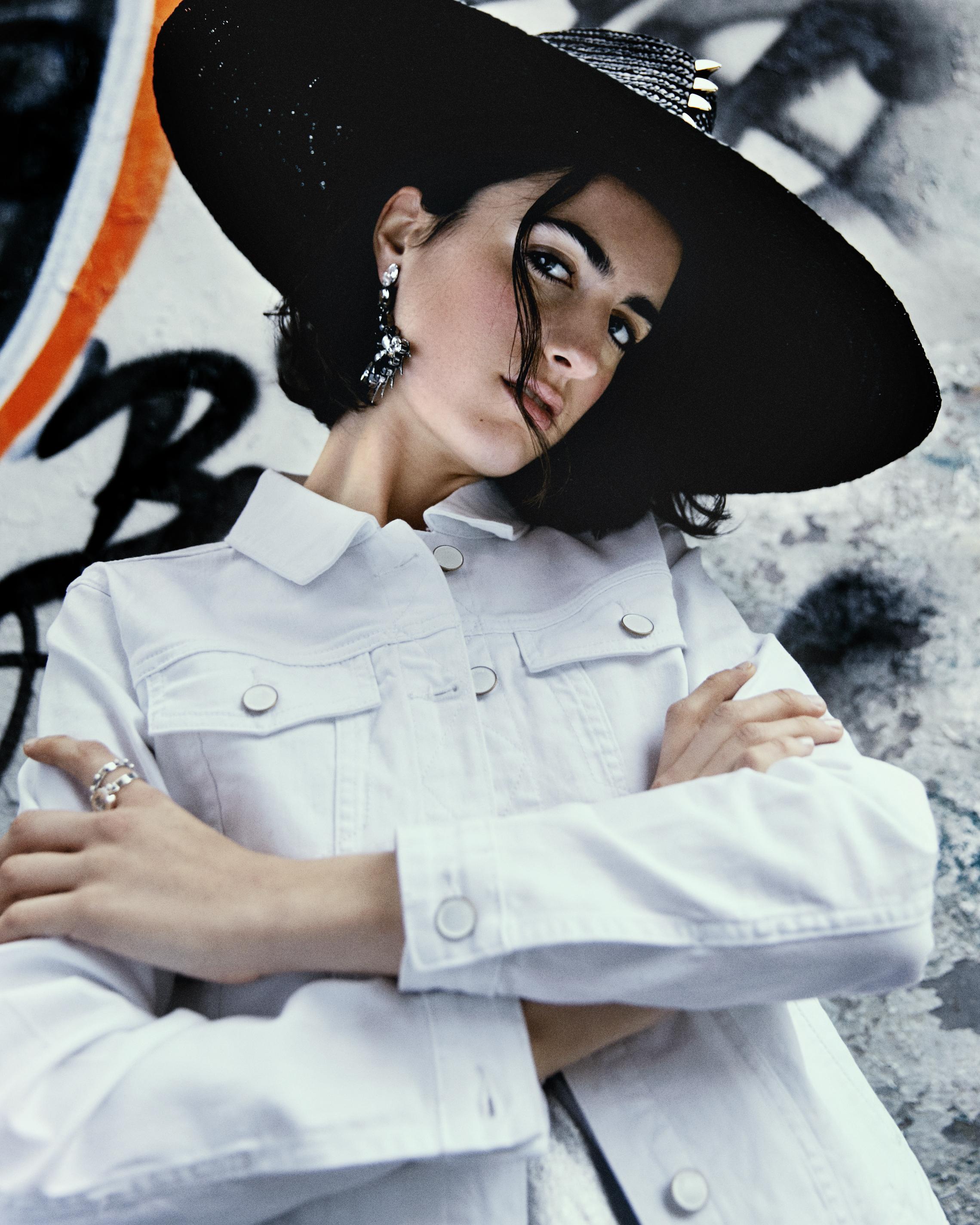 Hat – THAT HAT MADRID  Earrings – ALDAZABAL  Rings – SANTAVANITAS  Jacket – AMICHI  Trousers – ANONYME DESIGNERS  Swim suit – UONDI