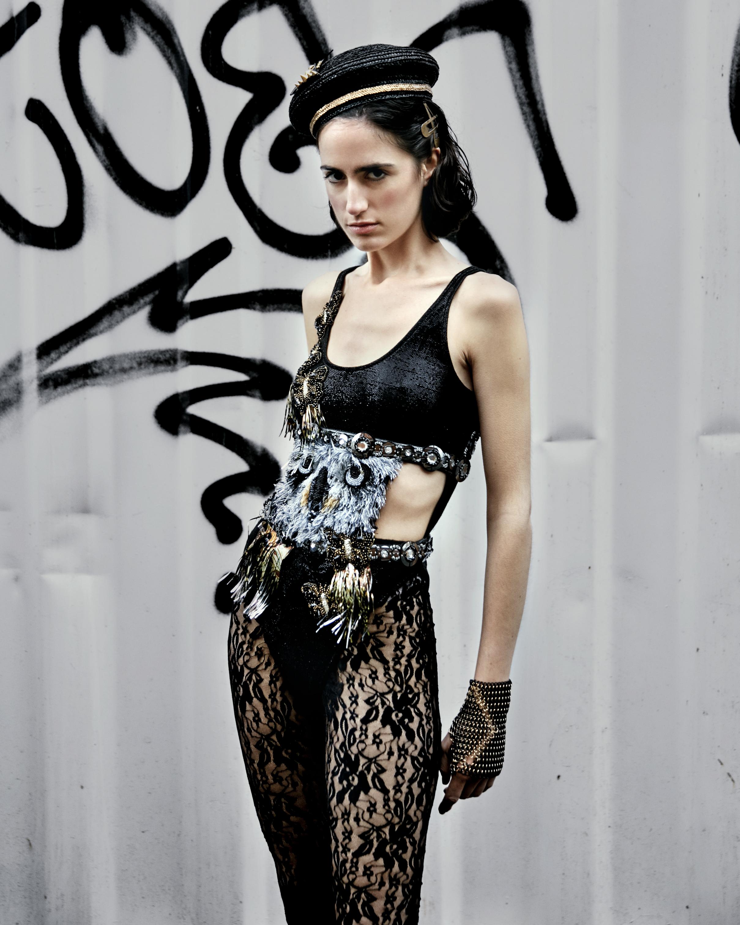 Trousers – LOS PECOS MUTANTES  Body – CUSTO BARCELONA  Hat – THAT HAT MADRID  Boots – PIMKIE  Bracelet – ELENA ESTAUN  Hair clips – CORTEFIEL