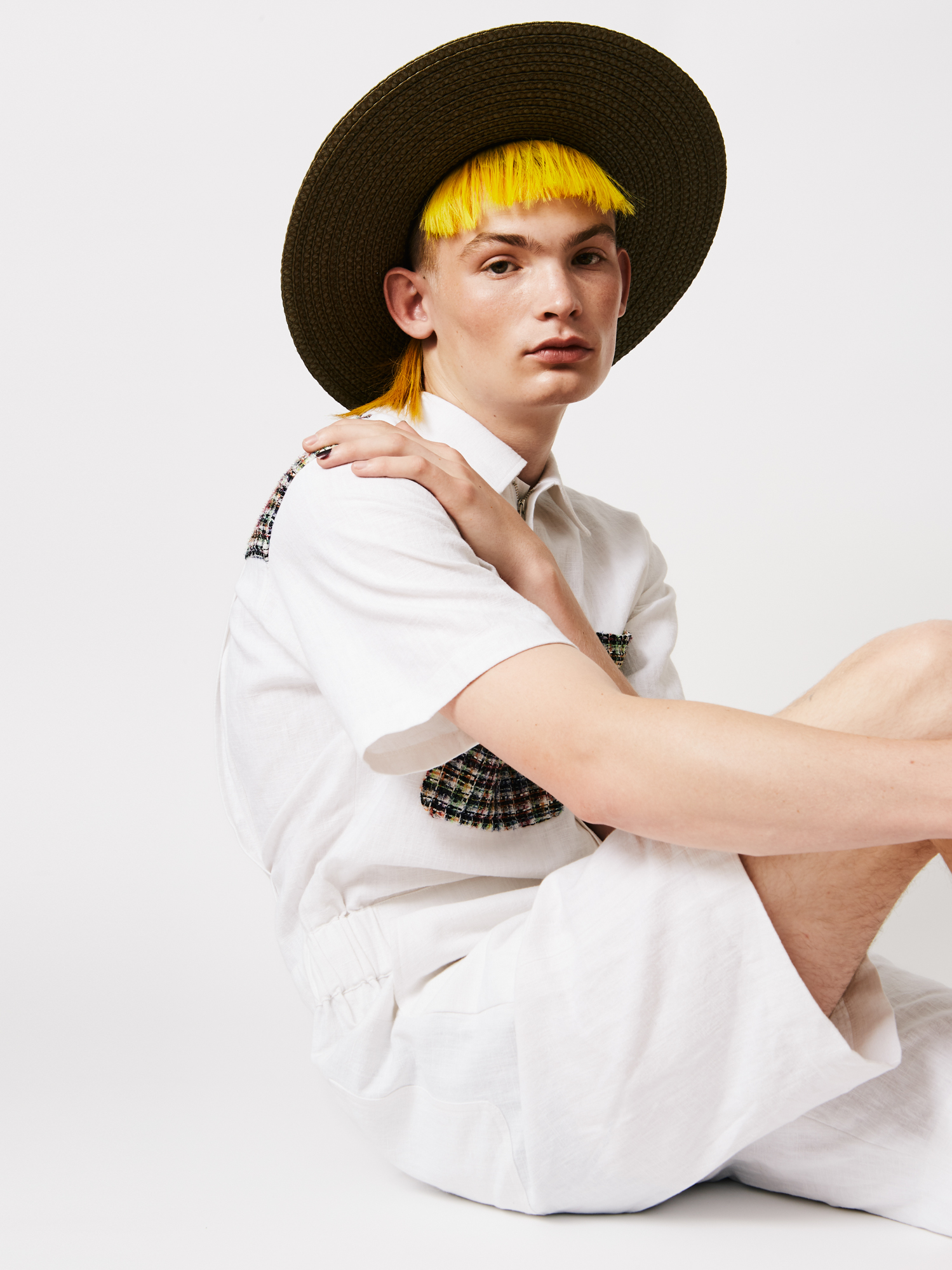 Romper by CAMOUFLAGED  Hat by Eric Javits