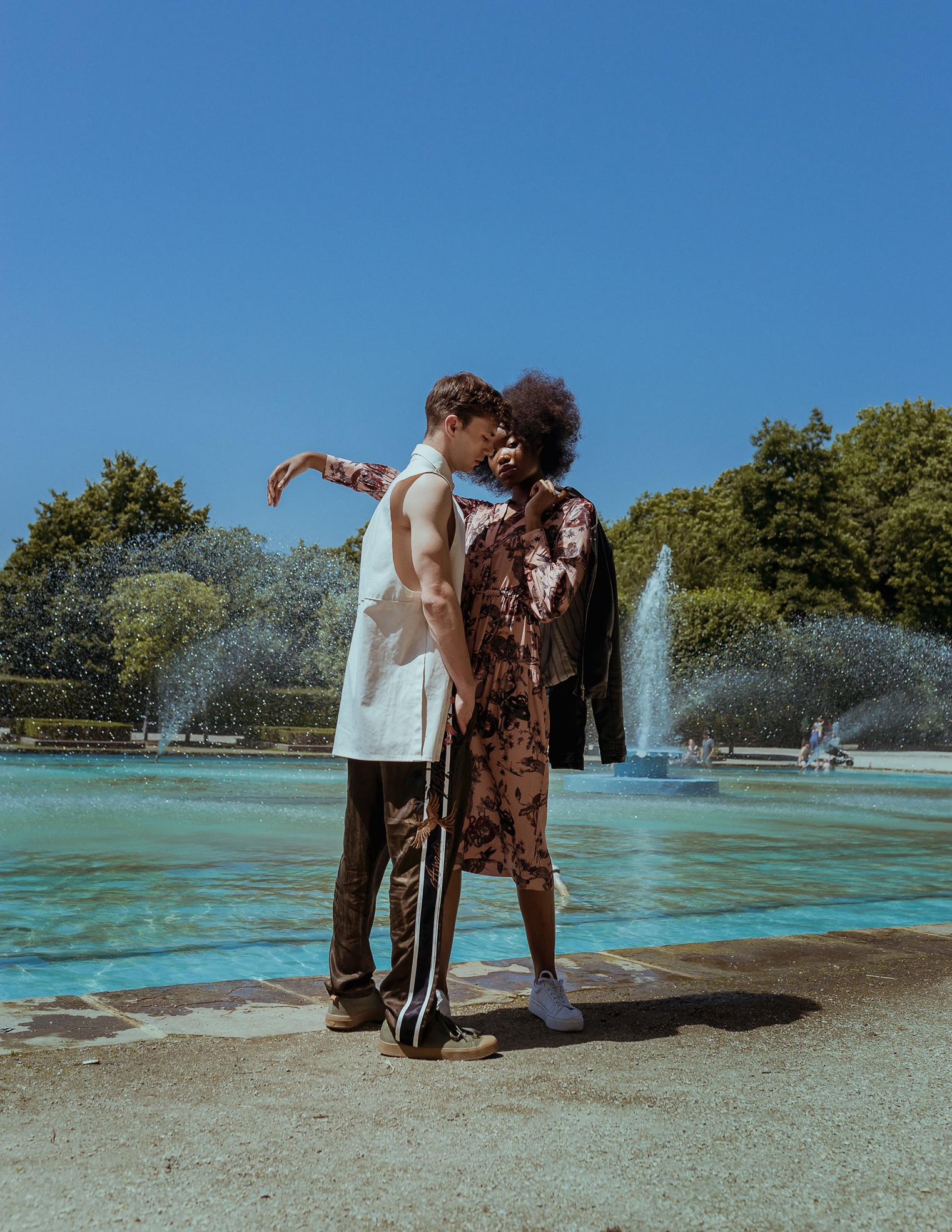 Alex //  White shirt  - Mayya Agayeva  Gloss Brown Trousers  - Scotch and Soda   Shoes  - Palladium  Anesu \\-  Pink exotic animal print dress  - Scotch and Soda   Leather Jacket  - Models