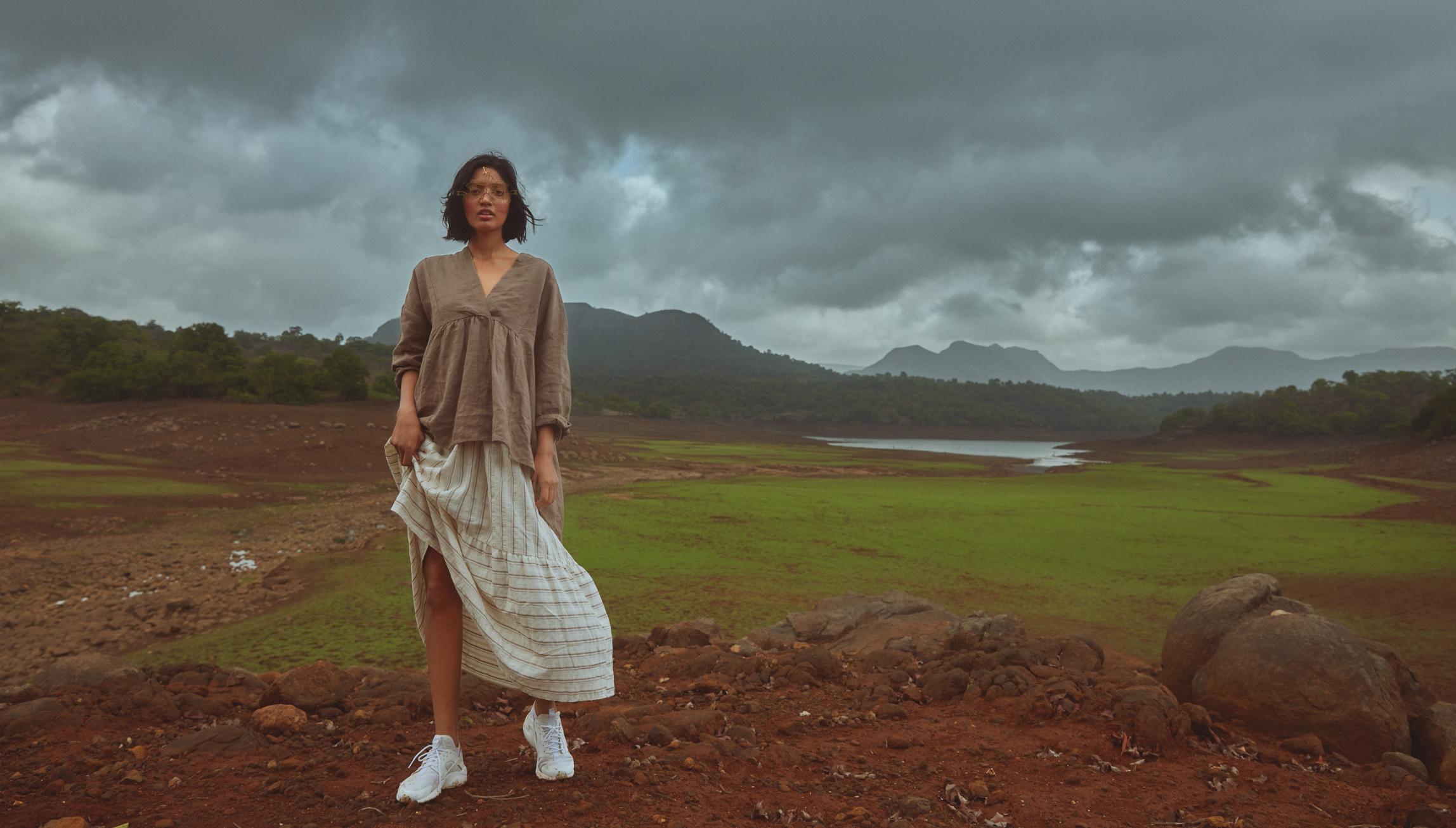 Asymmetric loose fit blouse & Ruffled poplin stripe dress from Zara; Metal eye frame from Roma Narsinghani; Nike Huarache.