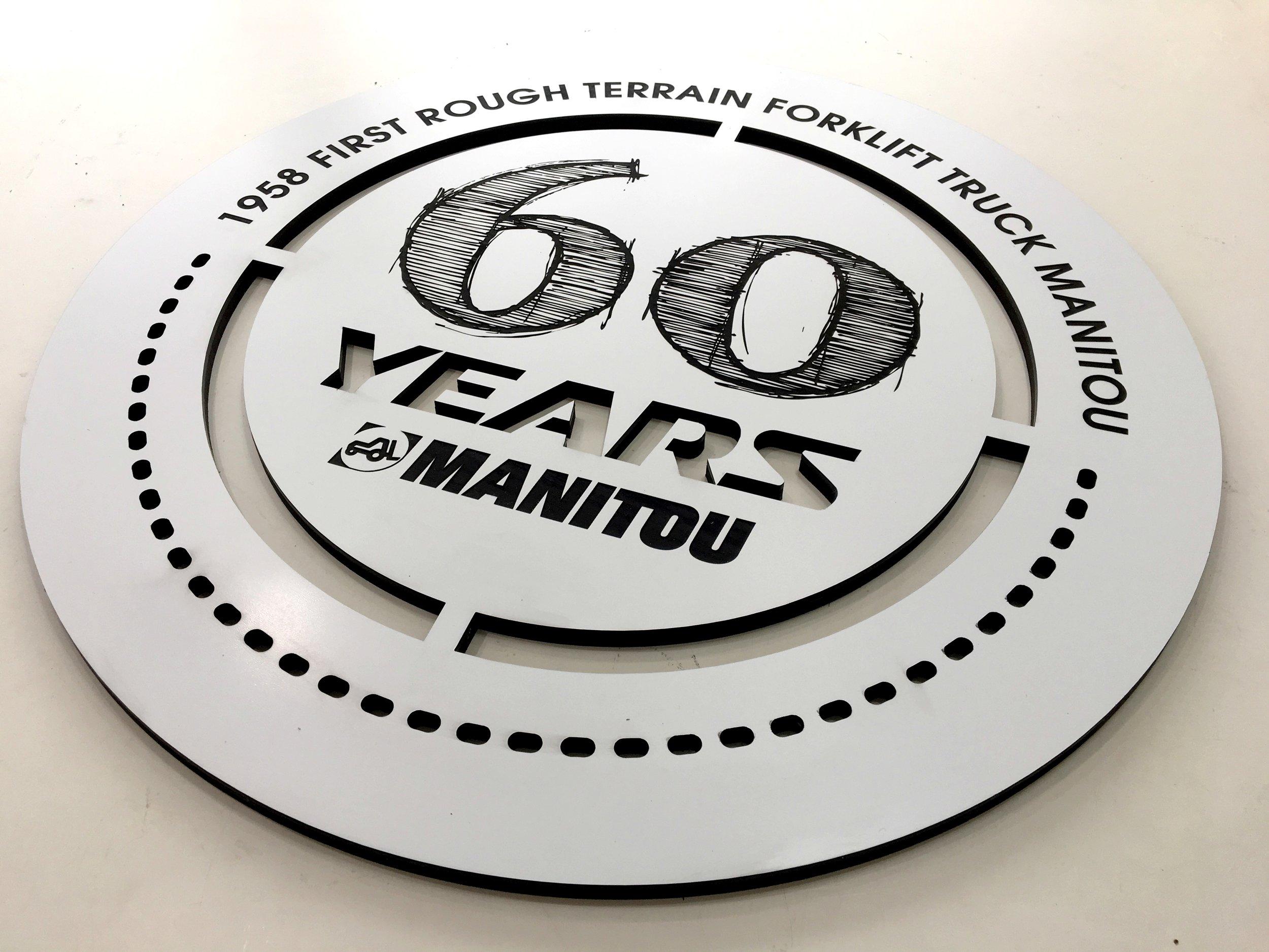 Signalétique gravée et découpée pour les 60 ans de Manitou
