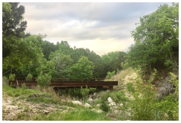 The bridge across the wet-weather creek takes you from the front to the back bluff at Havenwald.