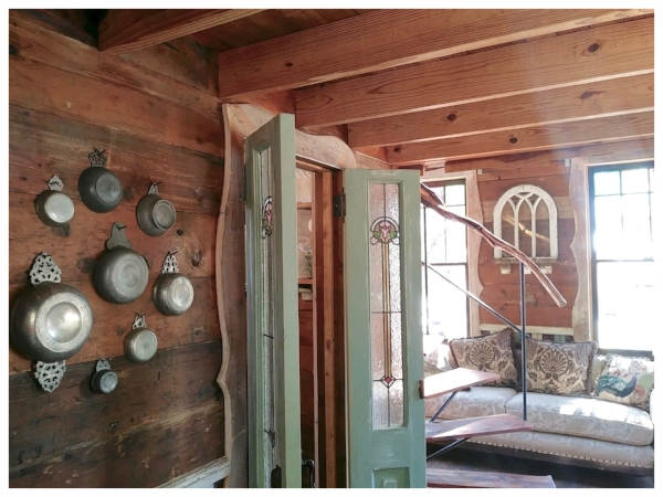 Shiplap, stained glass windows, antique hardware and vintage furnishings brought Robin Hood's Hideout to life.