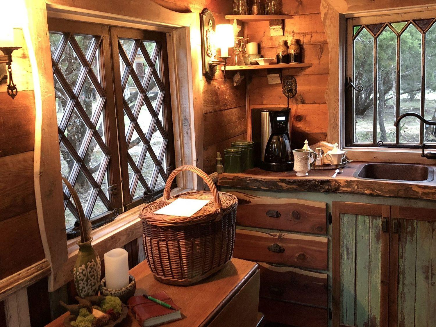 Robin Hood's Hideout - A whimsical, storybook cottage built with reclaimed shiplap, antique English stained glass and cedar.