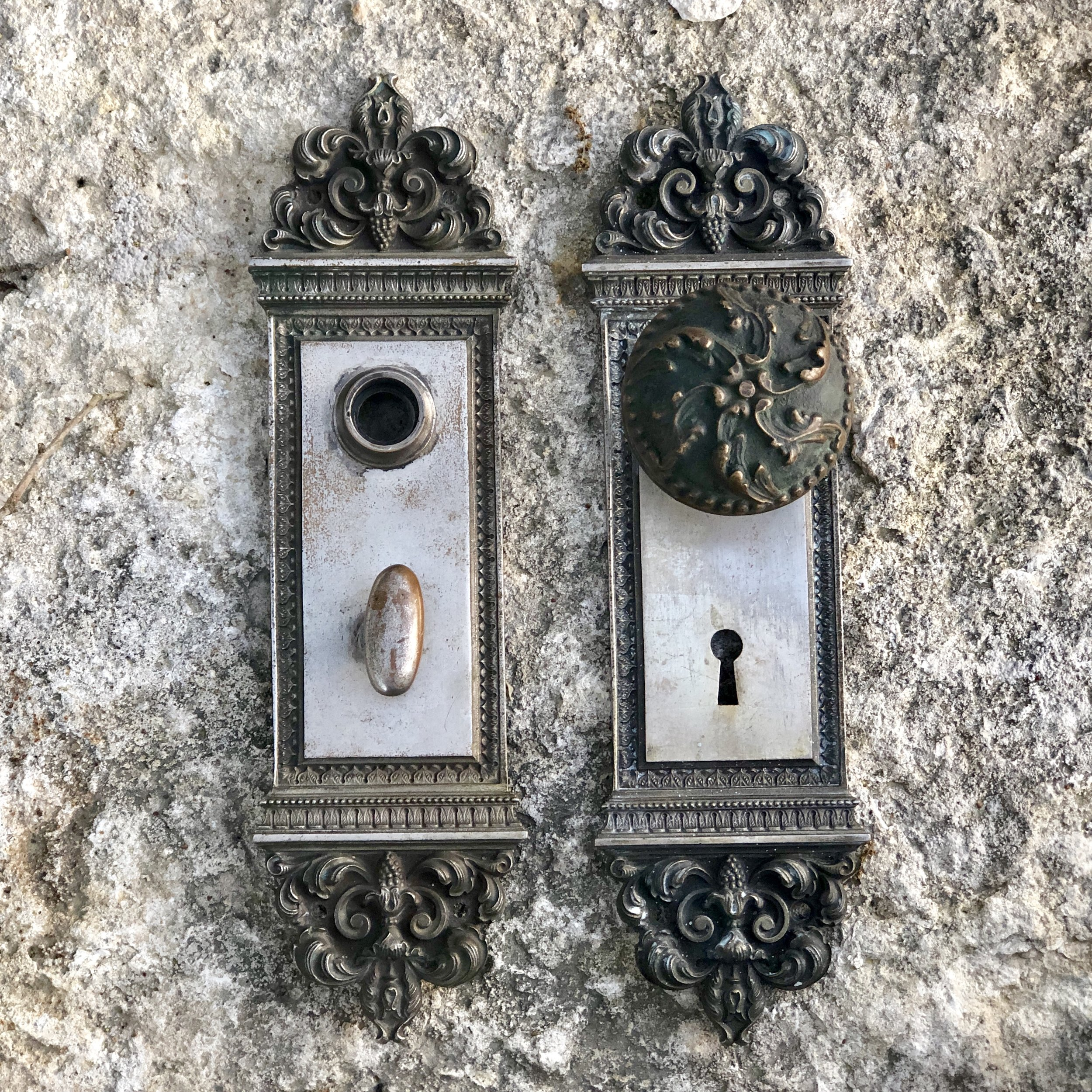 Antique door plates and a knob from the Victorian era.