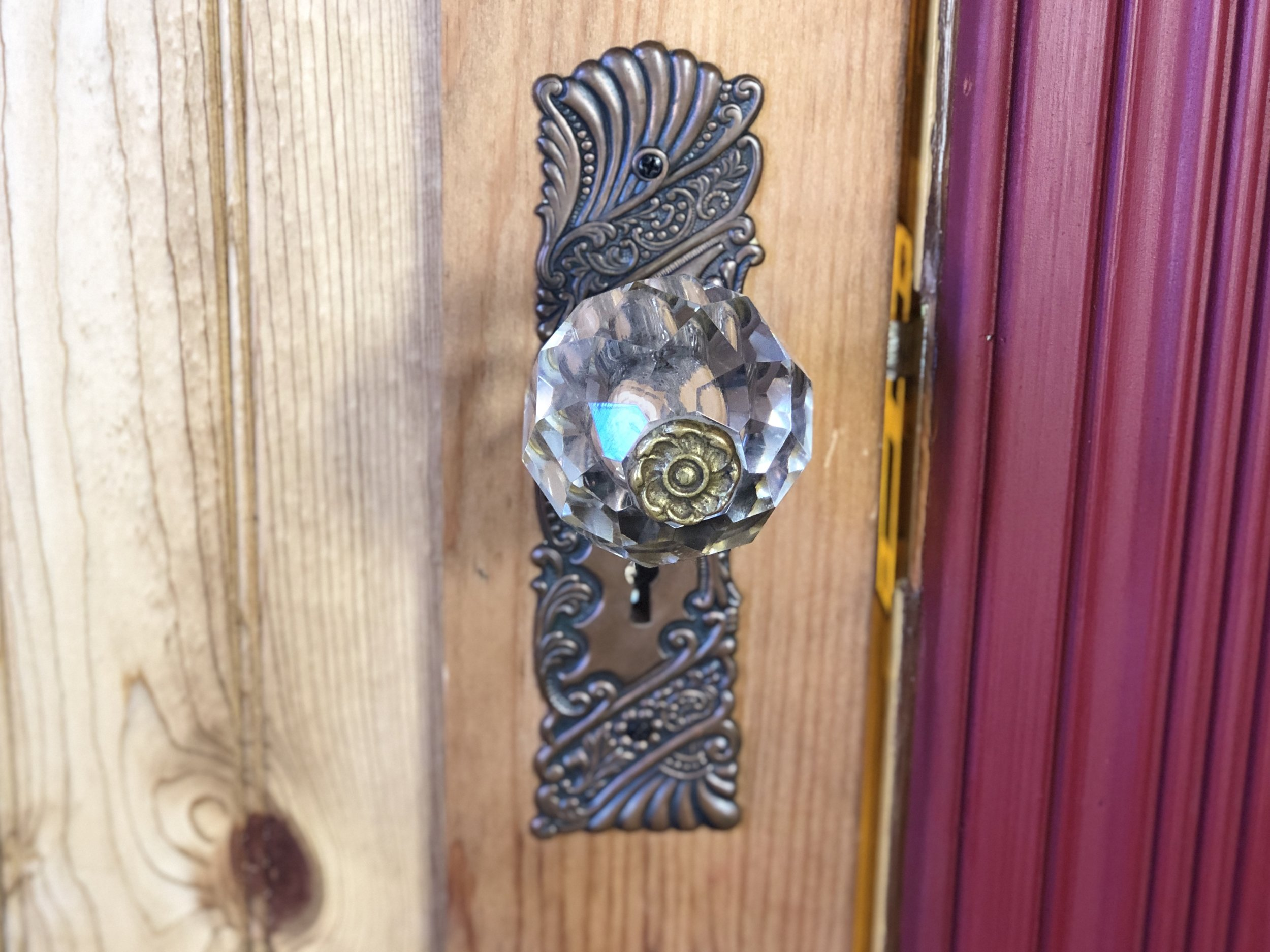 An oversized, whimsical, cut crystal and brass doorknob is perfect on our whimsical little caravan!