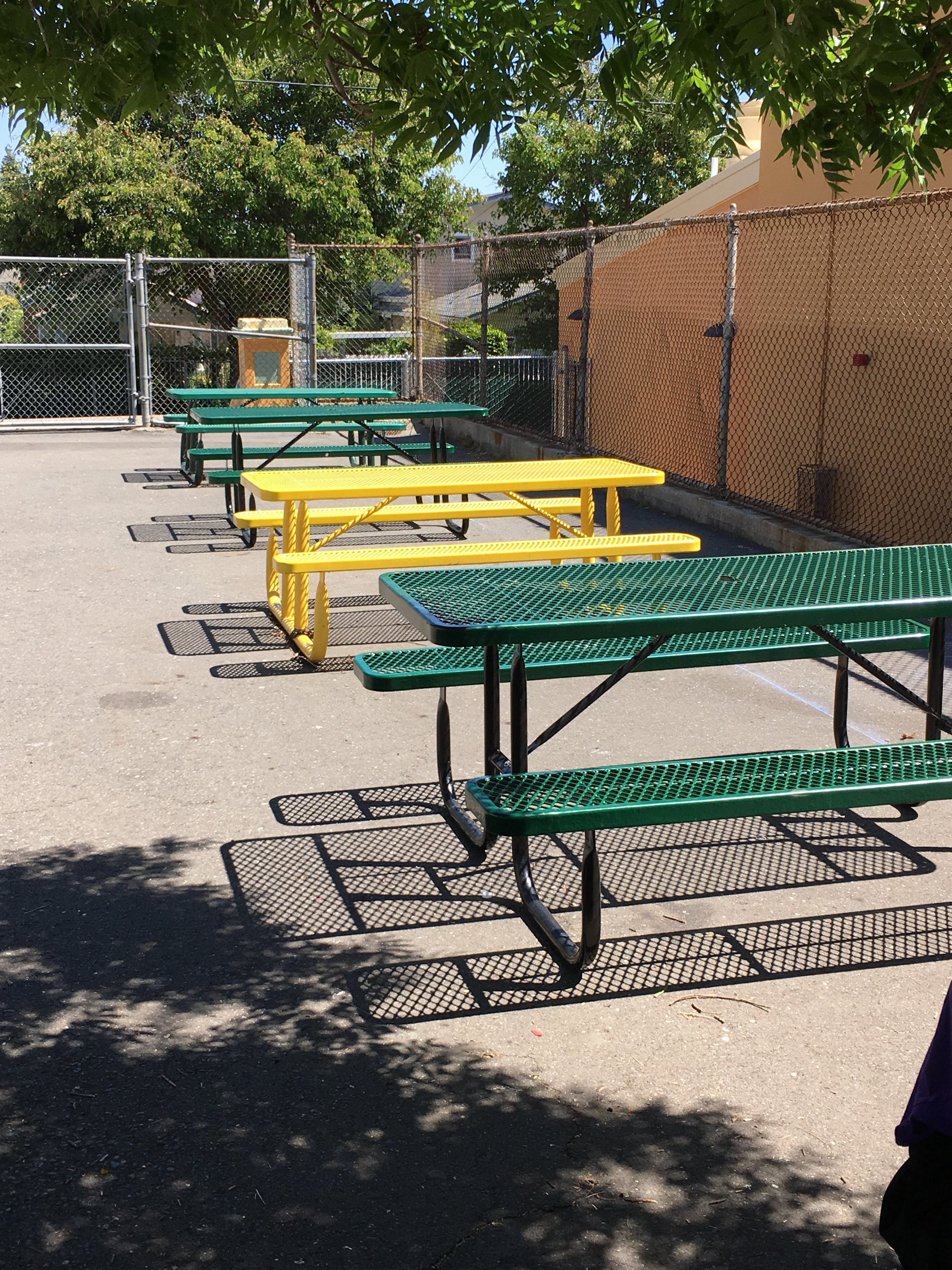 tables in upper yard view to Patterson St.JPG