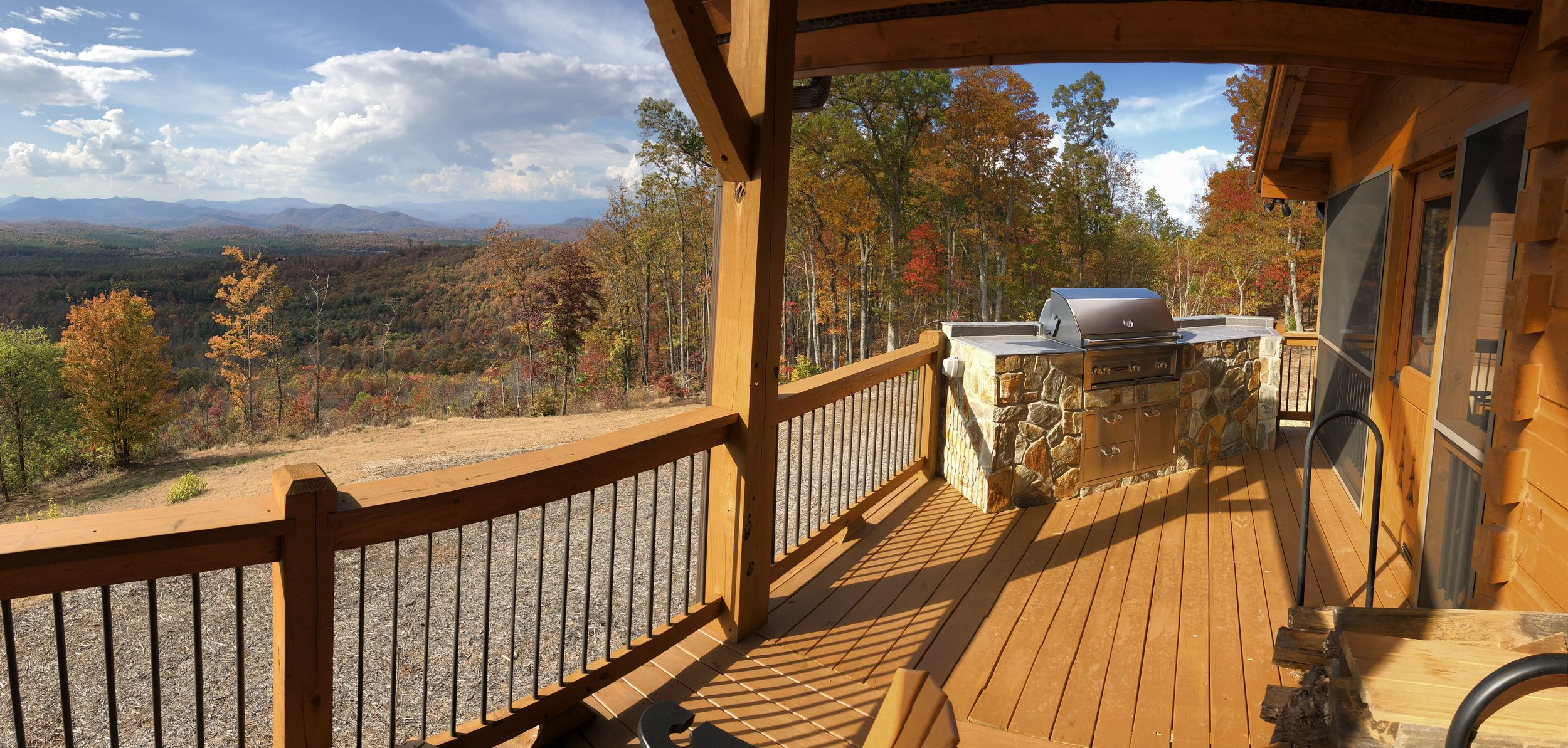View104 rental features a wraparound porch with views of the Blue Ridge Mountains and outdoor grilling station