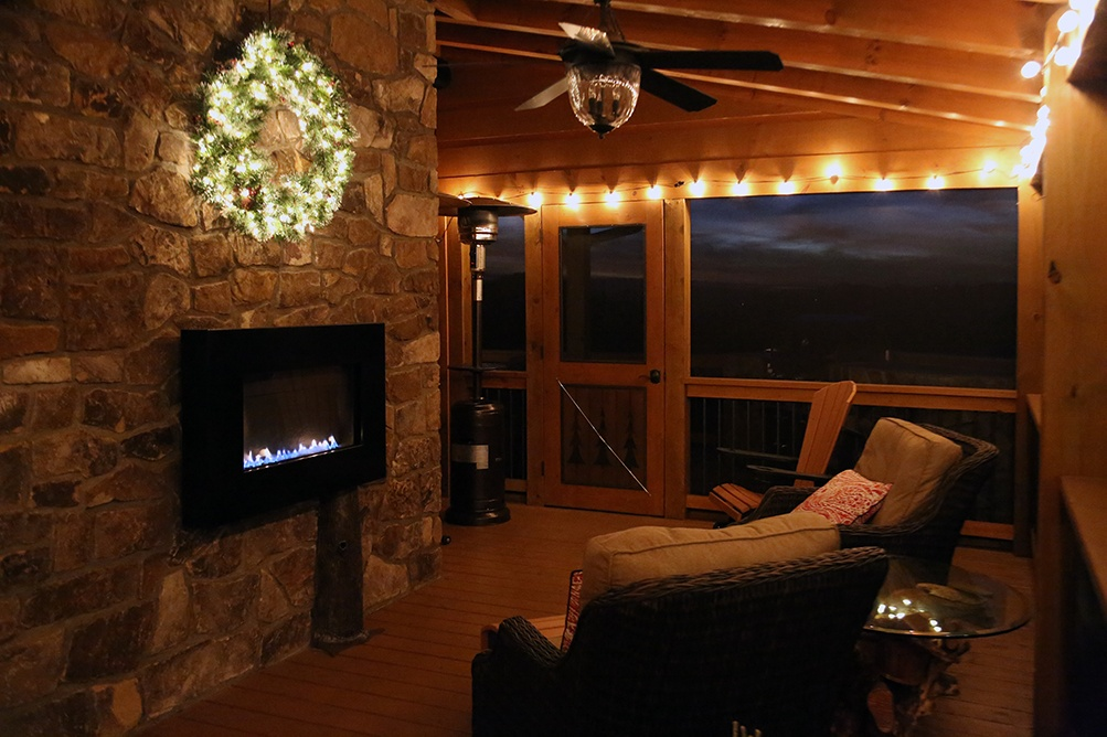 A private screened-in porch with gas fireplace is a great place for View104 guests to relax and enjoy the mountain views