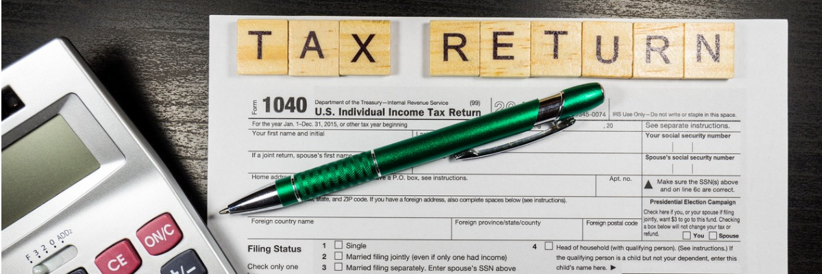 tax-return-form-with-a-pen-picture-id638773016.jpg