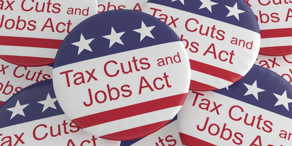 politics-news-badges-pile-of-tax-cuts-and-jobs-act-buttons-with-us-picture-id897796656.jpg