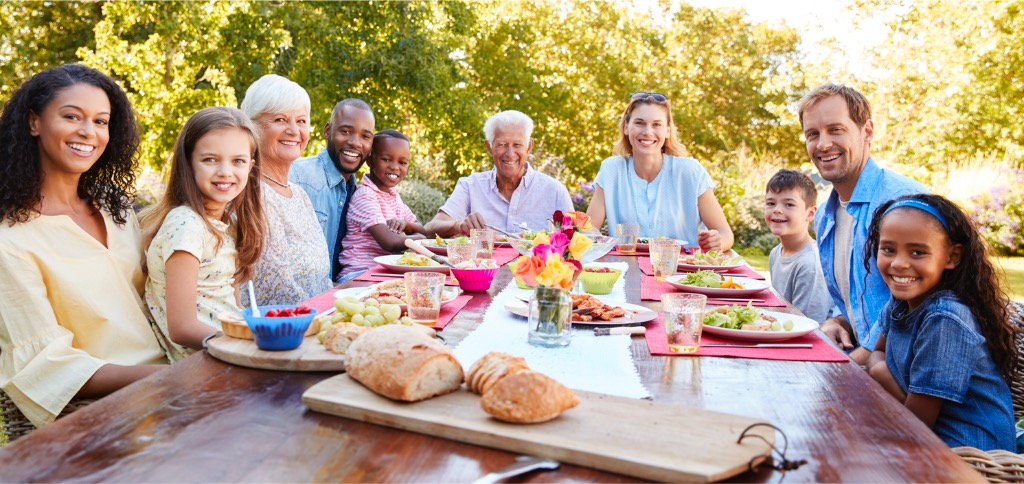 friends-and-family-having-lunch-in-garden-looking-to-camera-picture-id944596460.jpg