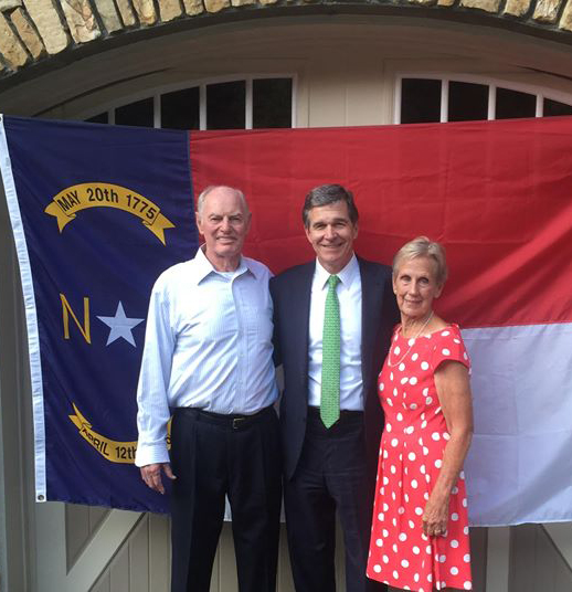 Bruce and Carol Peterson with Gov Cooper.jpg