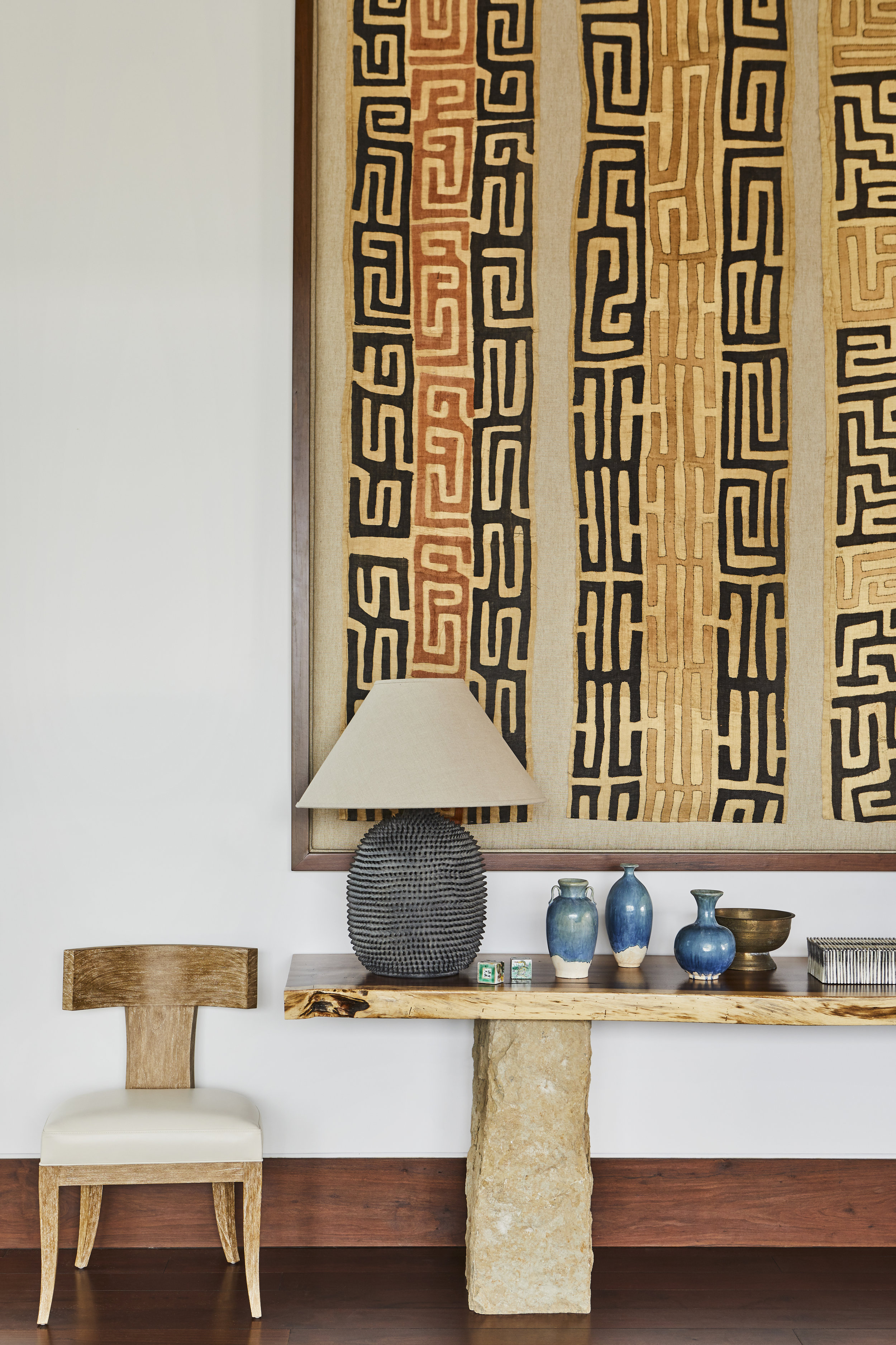 Kuba cloths stitched to linen artfully echo what's elemental. Photo source: Willetts Design & Associates.