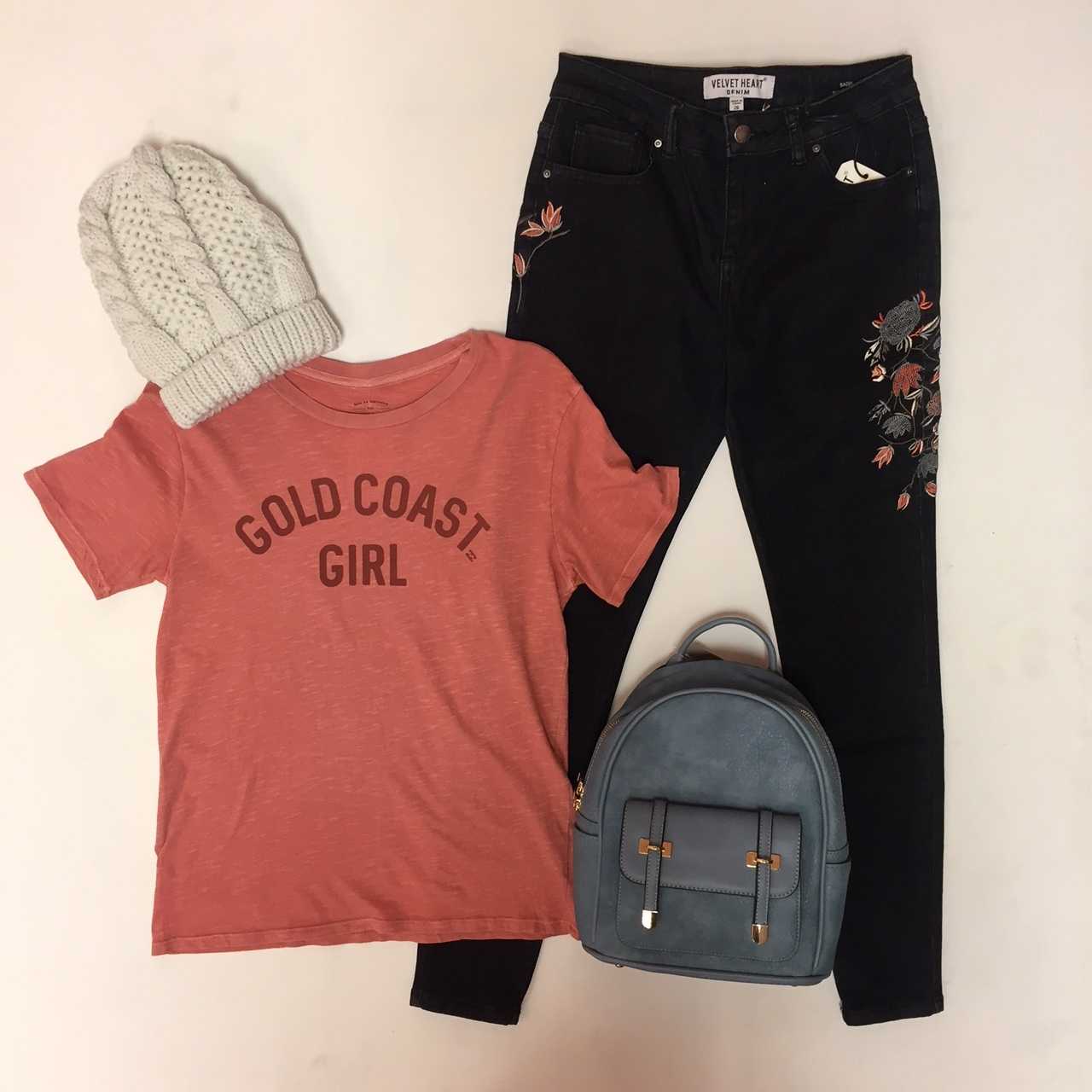 """Embroidered Jeans $79, """"Gold Coast Girl"""" Tee $29.95, Backpack $49, Hat $16"""