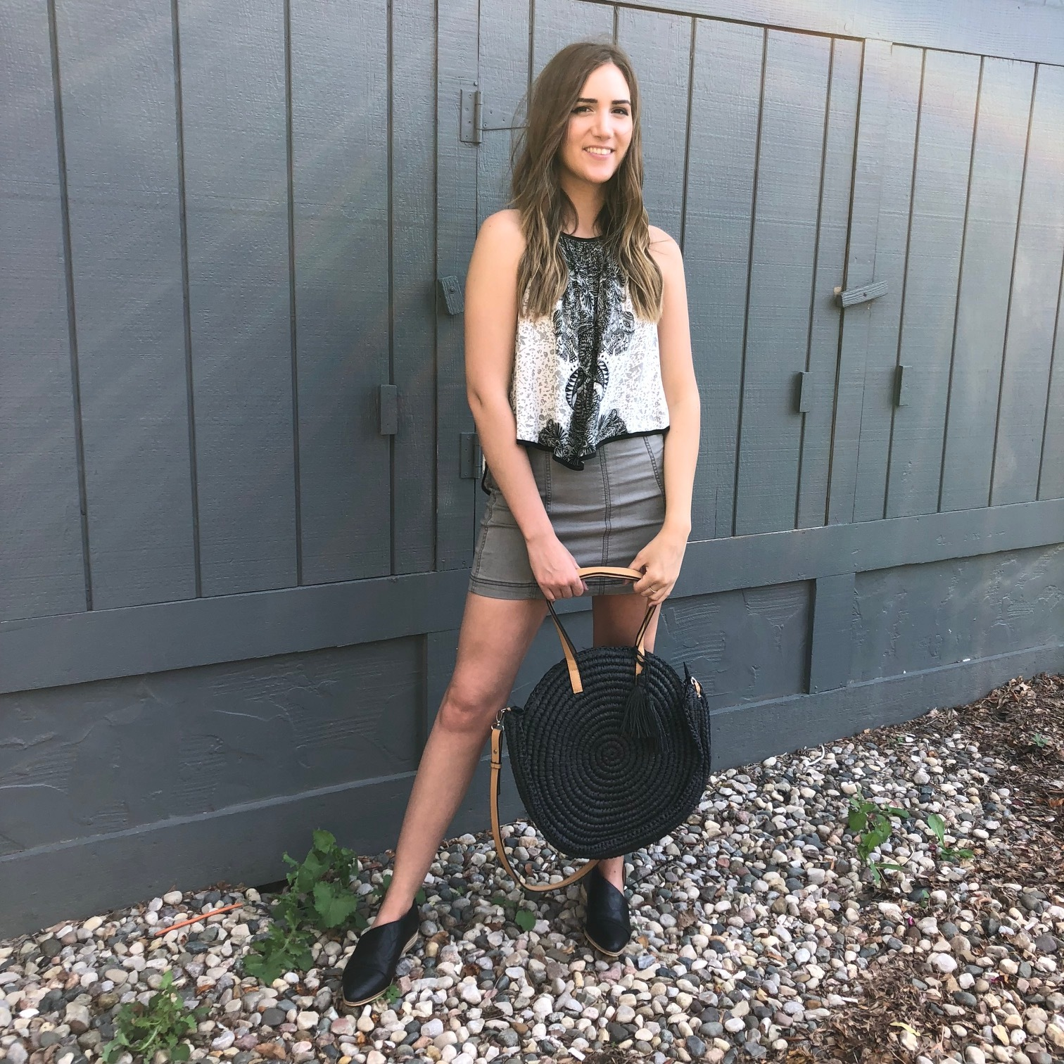 Free People Black and White Tank Top $68, Free People Modern Femme Mini $50, Straw Purse $42,Black Sidecut Loafers $42