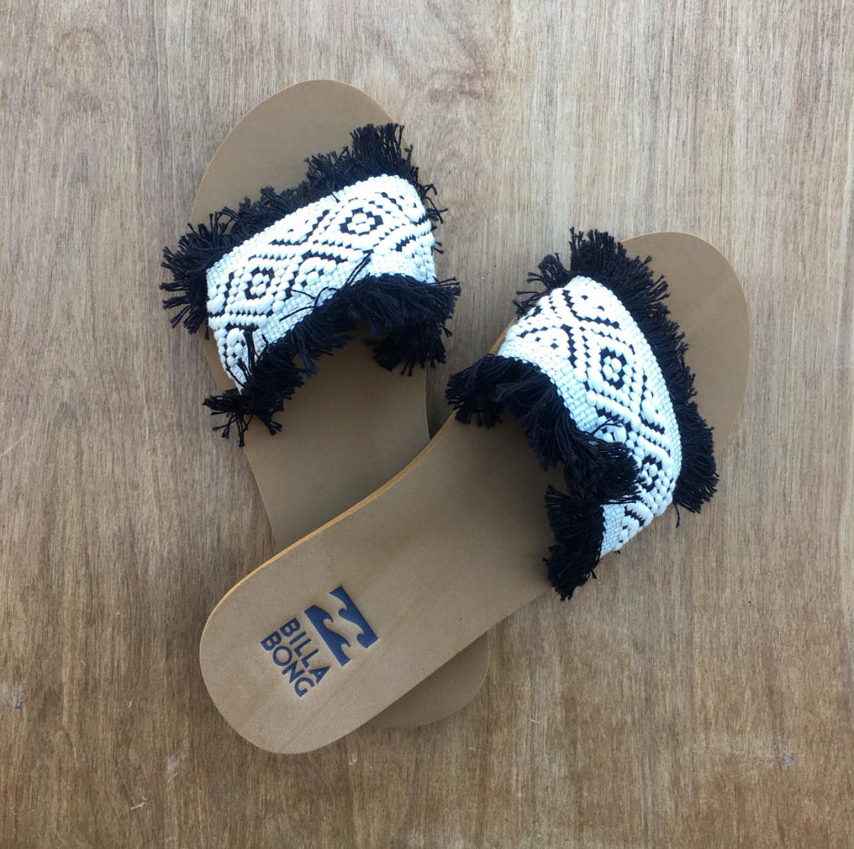 "#4 - Go-to beach brand Billabong is a spring break staple.Throw on their "" One Way"" Sandals to add a funky final touch to any look!"