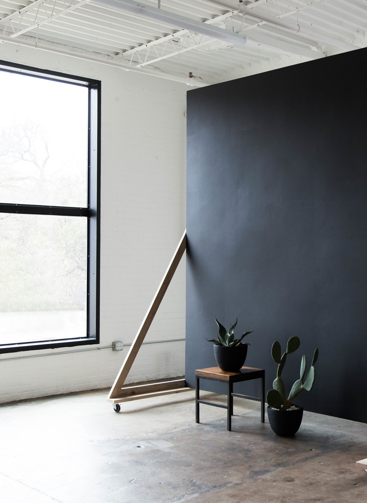 STUDIO I - Just over 900 sq. ft. of space to create the perfect portrait. Two large, south facing windows allow for even, soft light throughout the afternoon and large, blank space on the east and west walls allow you to manipulate the light in multiple ways.