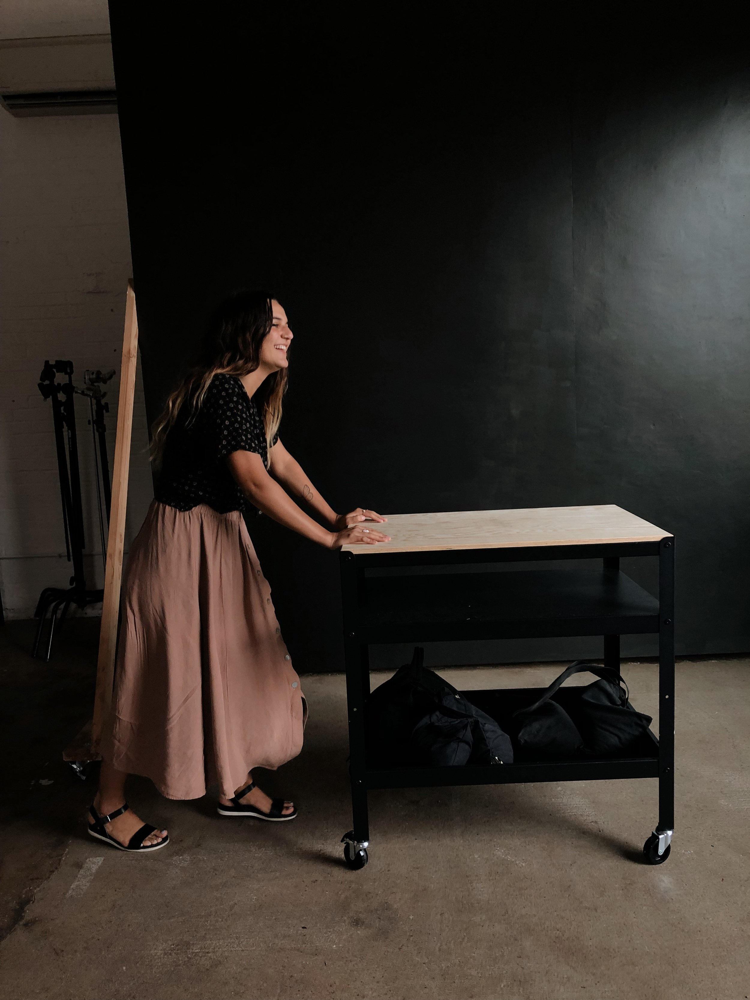 Use the props in the studio- Even Items that you wouldn't necessarily think are photo props, can be used as a prop. Example? (repurposing the caption cart as a posing surface.) - tip no.2