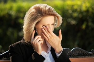 WOMAN CRYING ON CELL PHONE
