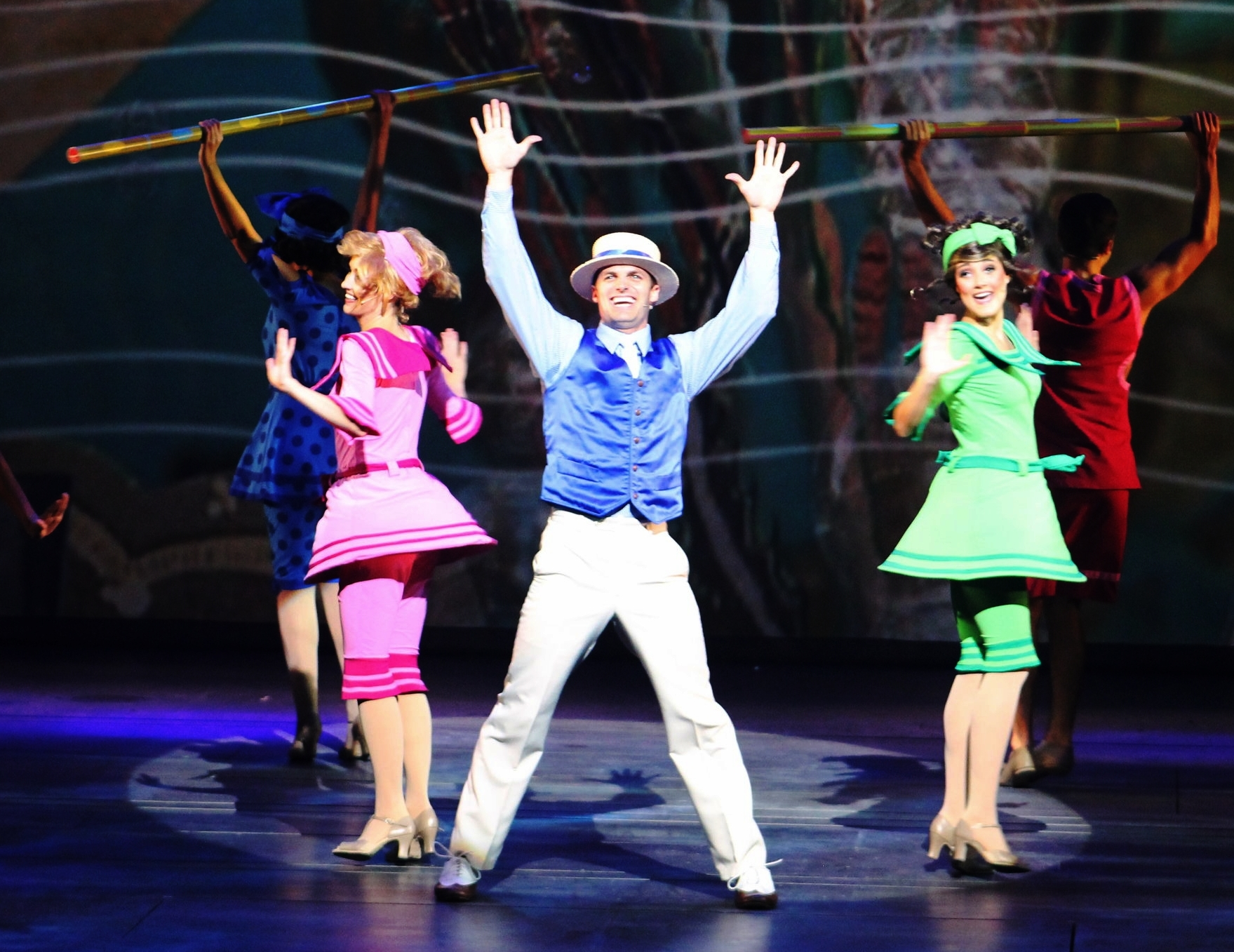 "Peter singing ""Under the Sea"" on Disney Cruise Line with his wife, Kat, dancing in the pink!"
