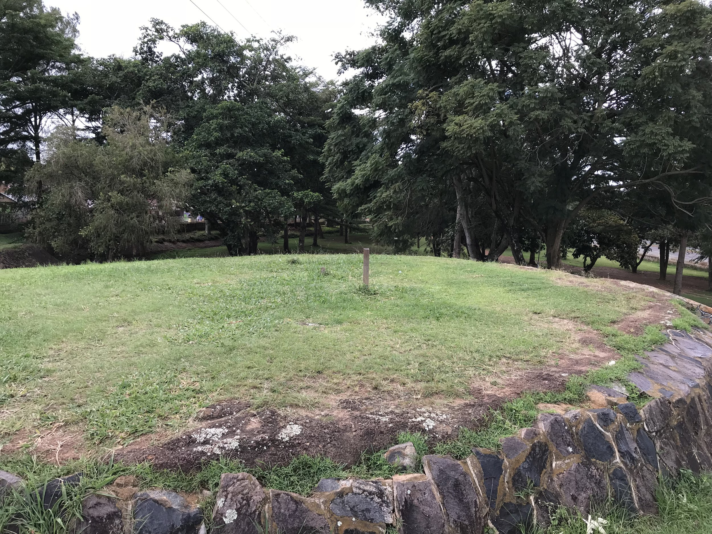- Upon entering the park, we saw a mighty mound in our vicinity. We got to learn that this mound had previously housed three flags; the Ugandan Flag, Entebbe municipality Flag and East African Flag. Due to theft , the space was now left vacant.  The Mayor's garden was officiated by the president of Uganda in 1994 however, the plaque with its inscription was scratched  off over the years.  The decision to build a monument onto this vacant space was made based on the fact that this move would evoke more reflection on the act itself in consideration of the political contention that the unresolved murders stirred last year. The plan for the coming weeks is mobilising the local community of Entebbe to participate in our interactive and performative project. We are truly excited and grateful to have come this far!