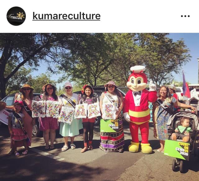 Patiently waiting for the parade to start, we managed to snap a photo with the Jolly Bee!   (Photo credit: Kumare Culture)