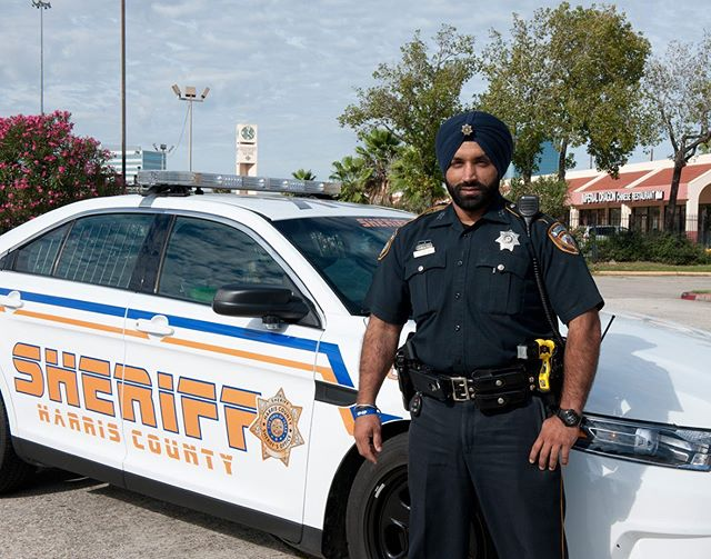 """This month's Faces of Sikh Law Enforcement """"FOSLE"""" feature is Deputy Sheriff Sandeep S Dhaliwal of the Harris County Sheriff's Office located in Houston, Texas. Deputy Sandeep S. Dhaliwal migrated from Punjab, India in 1994, at the age of 16.  After college he owned a Pizza shop from 2007 to 2008 which he ran with his wife. During his time as a shop owner, he witnessed hate crimes -- sometimes geared towards the Sikh community in Houston. He states that he always felt the need for representation of the Sikh Community in law enforcement.  On one occasion in 2007, Sheriff Adrian Garcia of the Harris County Sheriff's Office was visiting the Sikh Temple of Houston where Deputy Dhaliwal was present in the congregation. Unbeknownst to Deputy Dhaliwal, this would be the day that he would choose a different path than he had ever imagined. At the temple, Sheriff Garcia spoke about a recent incident where the local Deputies mistook the Sikh Gatra as a knife or weapon.  A Sikh man was detained when he refused to remove it.  After the incident, Sheriff Garcia was at the Sikh Temple in a community relations capacity. Sheriff Garcia stood at the podium and asked the Sikh Sangat """" What have you done in past 50 years to educate local law enforcement or the public about your religion? Why doesn't one of you join this department? You can serve, as well as, teach the public and the department who you are and what you believe in.  This will eliminate future misunderstandings."""" That was Deputy Dhaliwal's calling.  In January 2008, Deputy Dhaliwal became the first Sikh to join the Harris County Sheriff's Office. Deputy Dhaliwal has proudly served on the Department to date. In September 2015, with joint efforts by the Harris County Sheriff's Office, the Sikh community of Houston, Texas, SELDF and the Sikh Coalition the option of wearing a turban while serving was approved for a full time regular duty Deputy.  Deputy Dhaliwal is notably recognized for his efforts in the Hurricane devastati"""