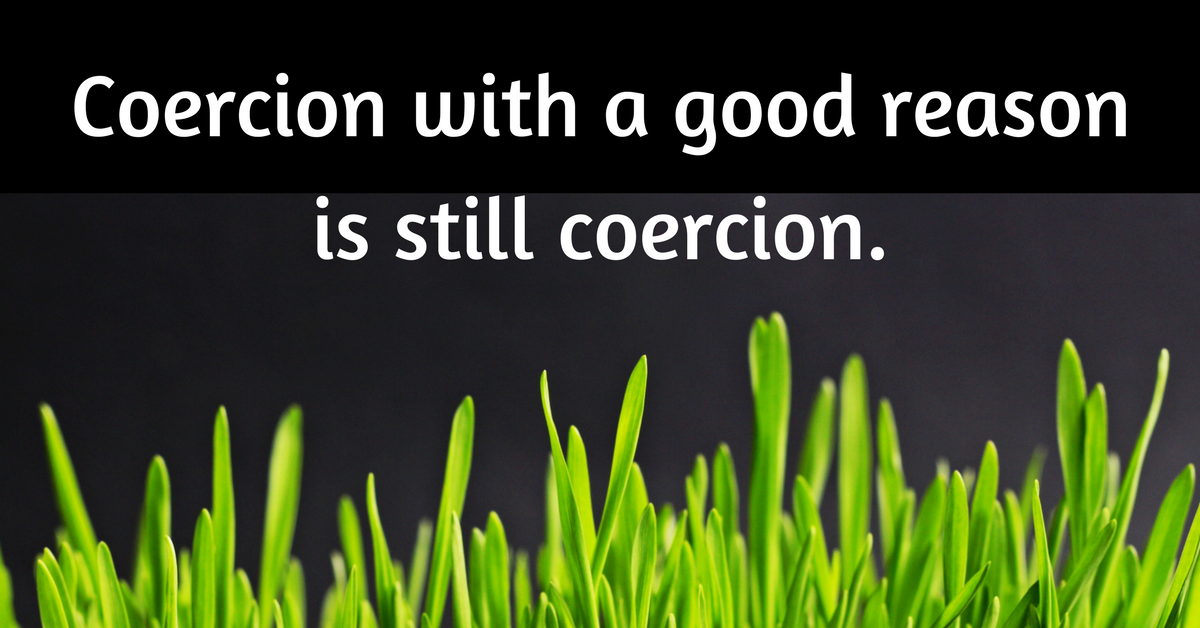 """Image description: Quote text """"coercion with a good reason is still coercion"""" on top of a photo of grass growing."""
