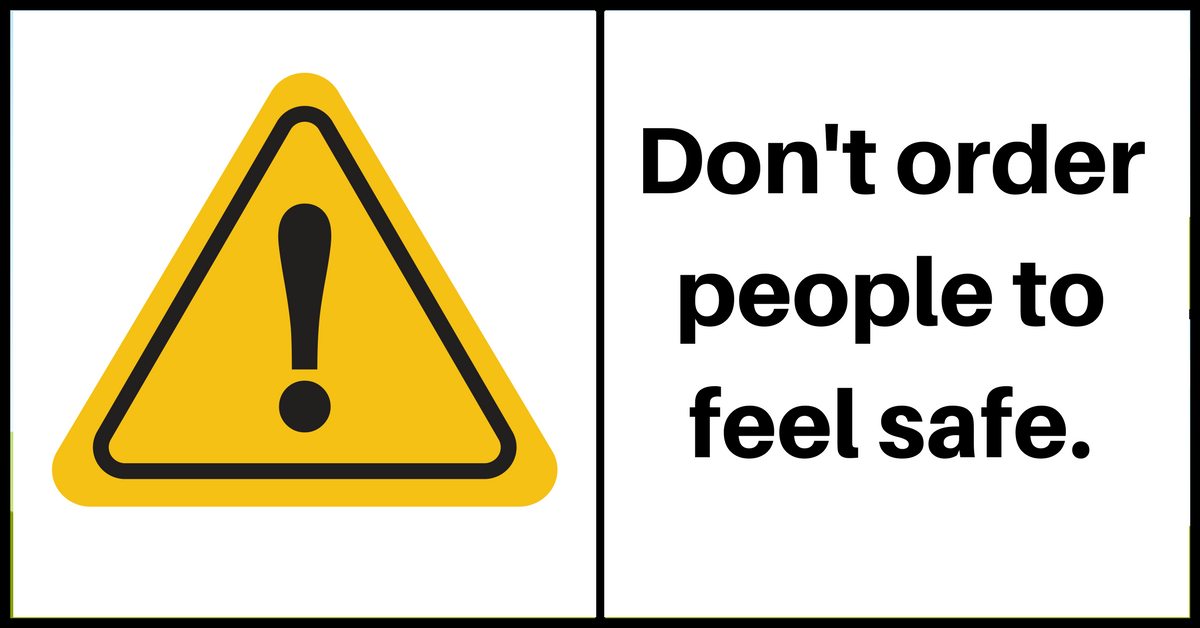 "Image description: A yellow caution sign next to text ""Don't order people to feel safe""."