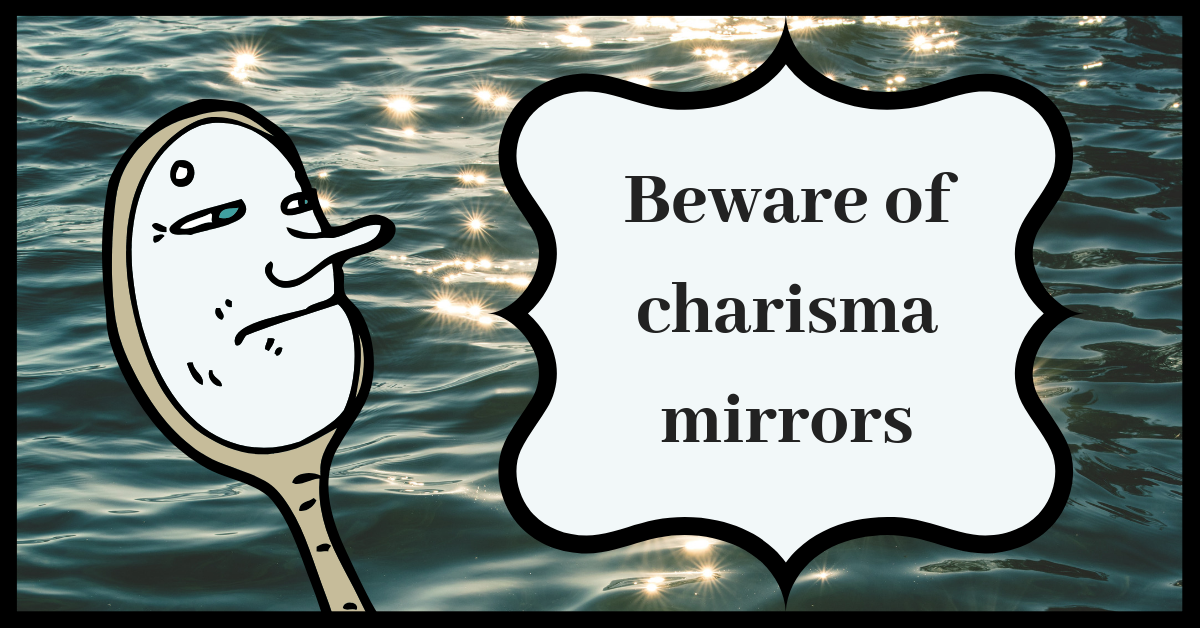 "image description: ""beware of charisma mirrors"" written on a vaguely mirror-like shape, next to a cartoon mirror with a cartoony mask face, on a background that's shiny reflective water"