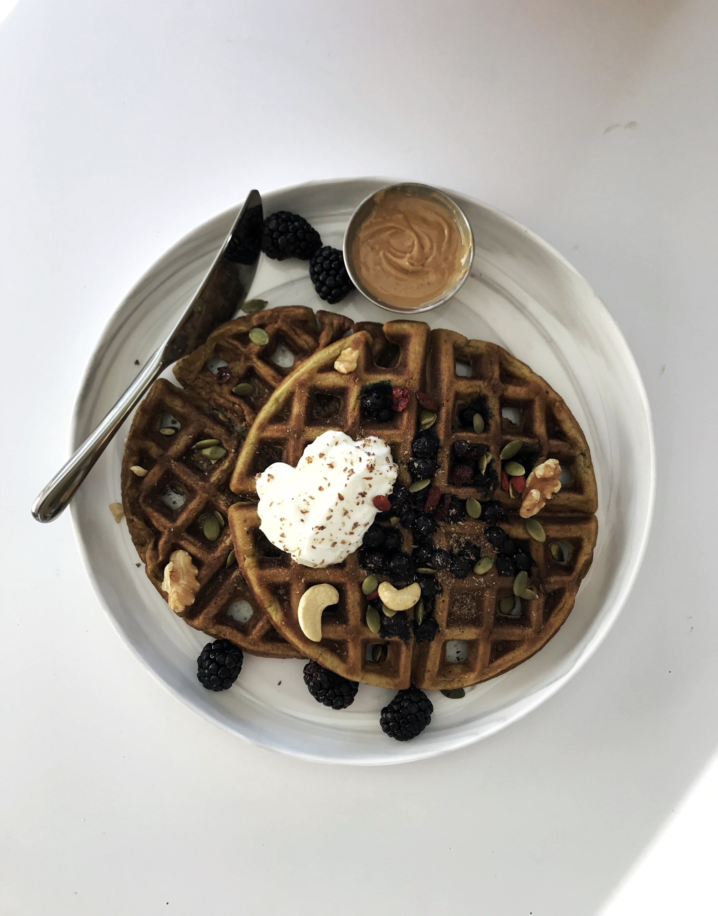 Bountiful Winter Waffles -  Makes 4 circular waffles, or 8 (ish) pancakes1/2 cup stone ground whole wheat flour1 tsp baking soda1/4 tsp salt2 eggs1 tbsp honey2 tbsp chia seeds2 tbsp Greek yoghurt1/2 cup almond milk2 tsp moringa powder (optional)Handful frozen berries