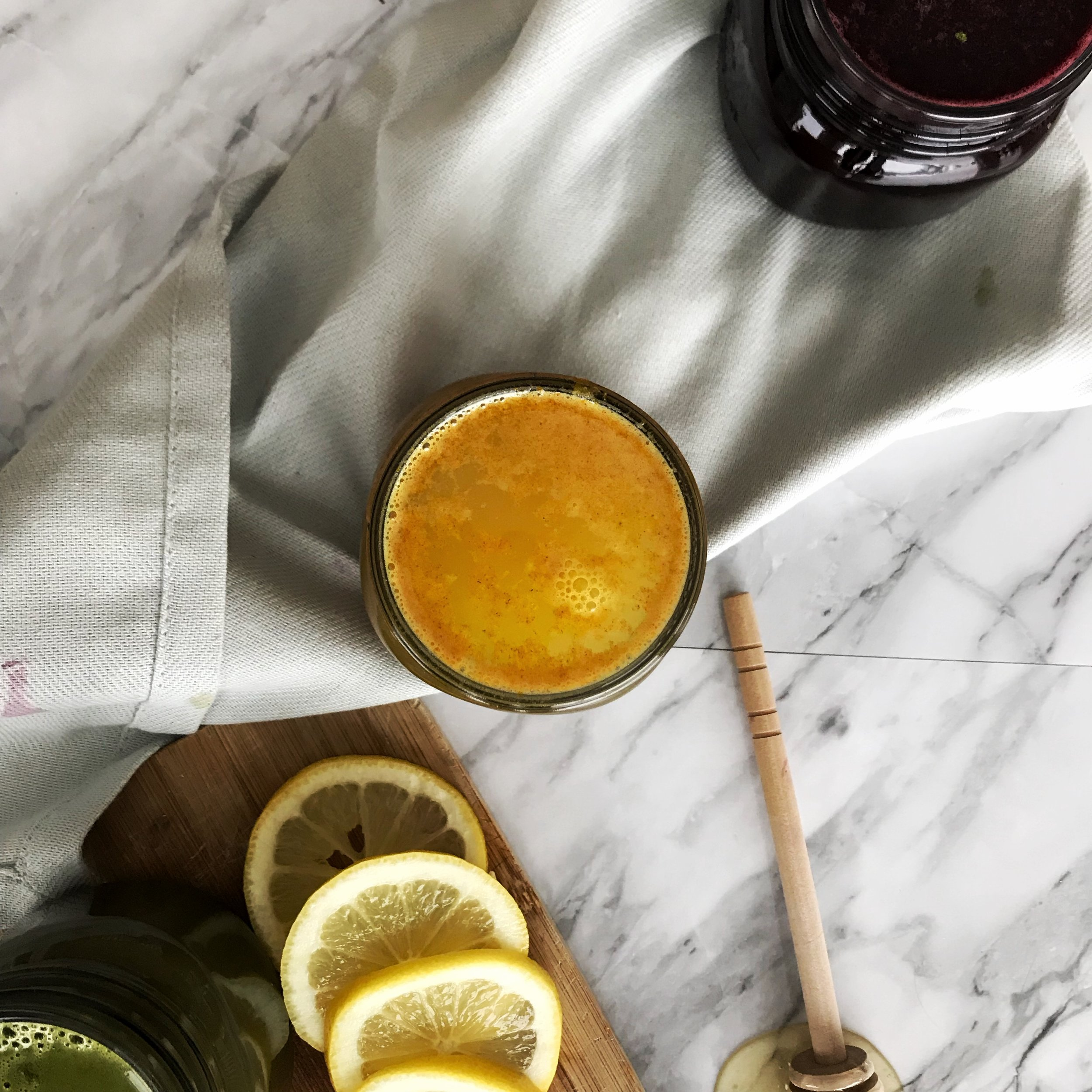 Turmeric Tonic - 1/4 tsp fresh ginger, chopped1/4 tsp ground cinnamon1/4 tsp turmeric powderA pinch of black pepper1/4 tsp honey to taste1 tbsp lemon juice8 - 10 oz hot water