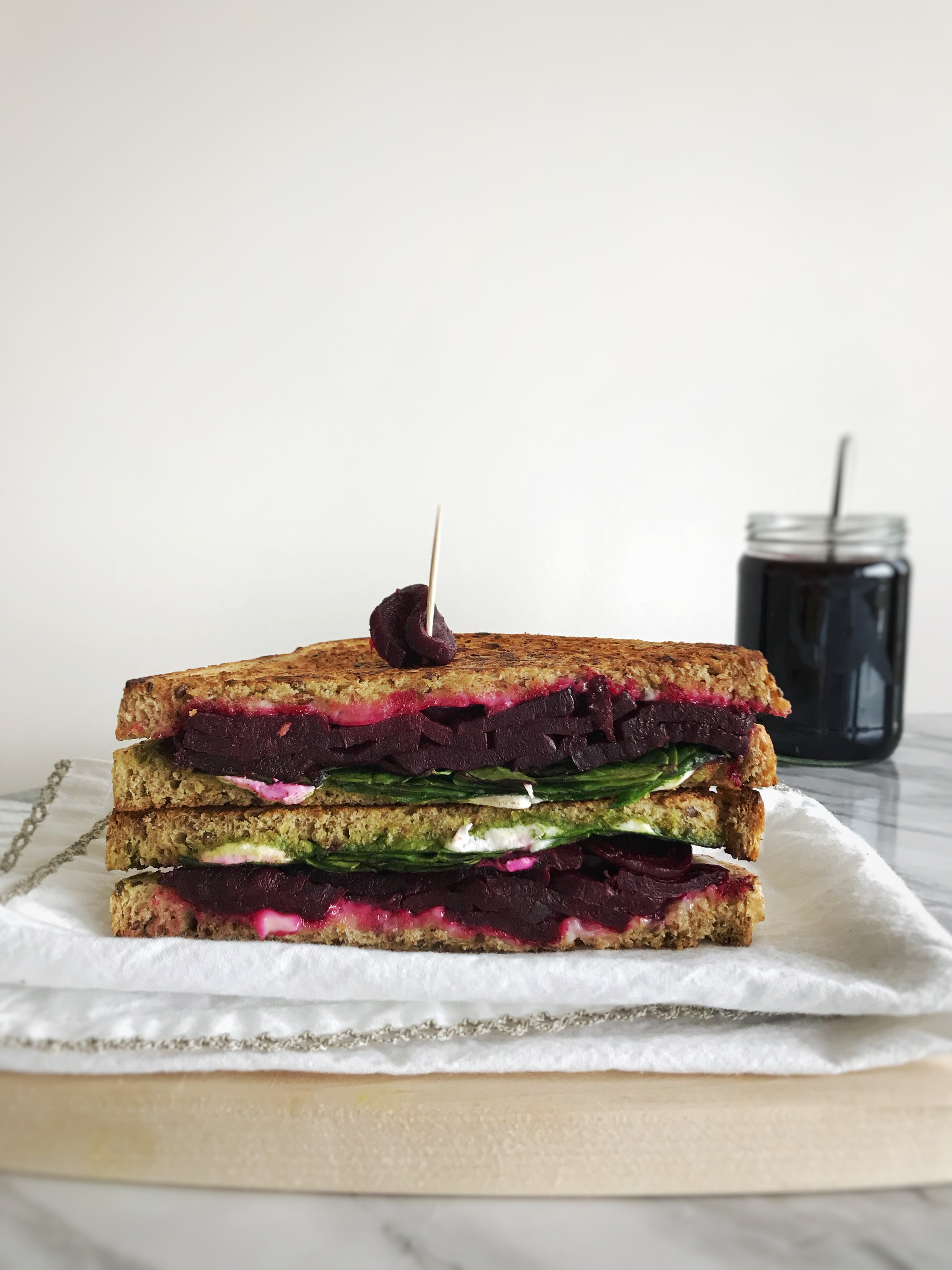 The Grilled Cheese Sandwich - Ingredients:1 roasted beet, sliced2 slices of whole grain, sprouted grain, sourdough breadHandful spinach1/4 avocado1 tbsp goats cheeseDirections:Preheat oven to 350F. Cut one medium sized beet in half, and brush with coconut oil, and your choice of herbs, salt and pepper. Cook on a sheet lined with parchment paper for 7 minutes, flip, then cook for another 5-7 minutes. Check that the beet can be punctured with a fork (it should be soft), then remove from oven, let cool slightly, and cut into slices.To assemble: Spread goats cheese on one slice of bread, then line with beet slices. Add spinach, then avocado, followed by the second slice. Spread coconut oil or ghee on either slice, then cook on a skillet until both sides are golden and crunchy.