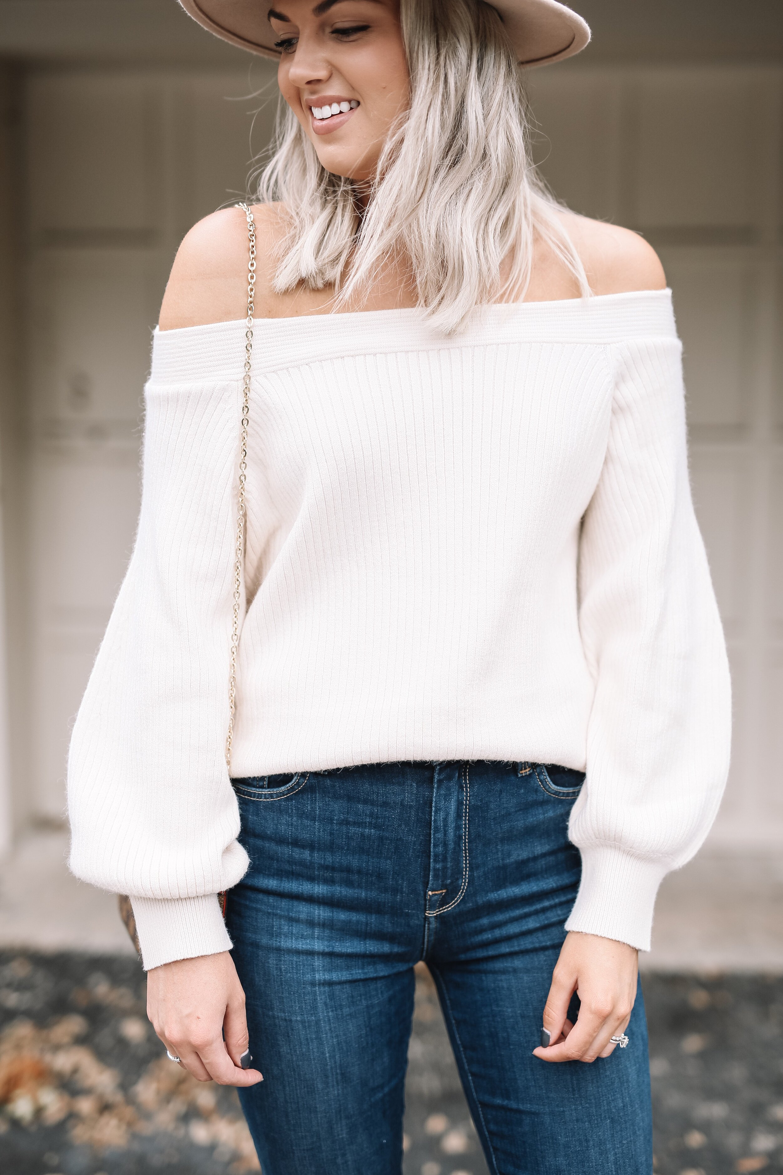 This sweater can be worn off the shoulder or on! Love the puff sleeve detail.
