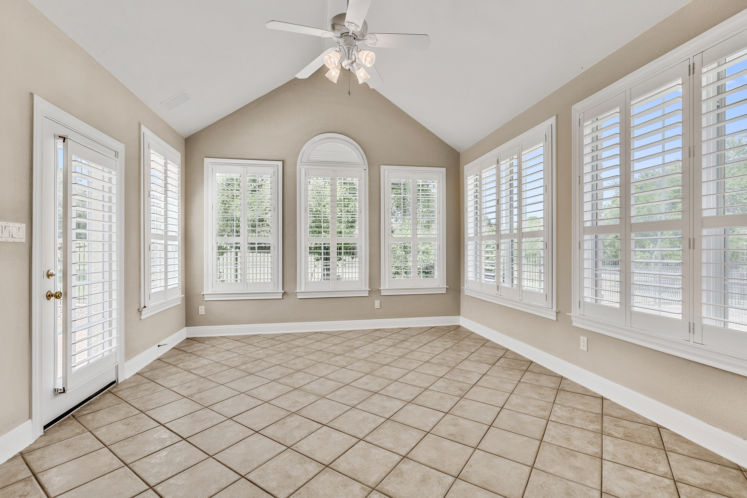 Stunning sun room with views of the golf course.
