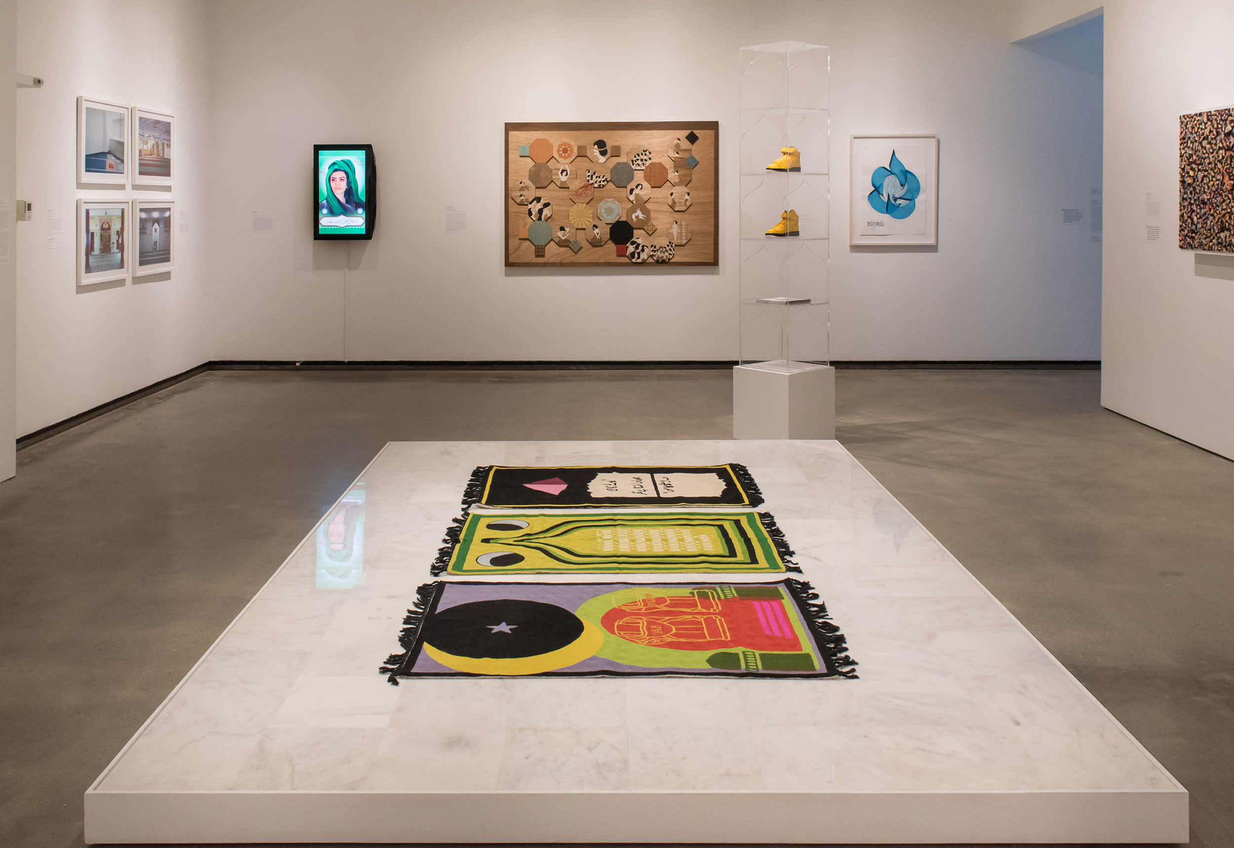 (From left to right)  Purple Heart, Lunar Count Down, Act Up, at  Katonah Museum of Art, NY,Handmade wool rugs custom designed by artist, made in Kashmir, India, 48 × 30 in, installed on marble platform, 2018