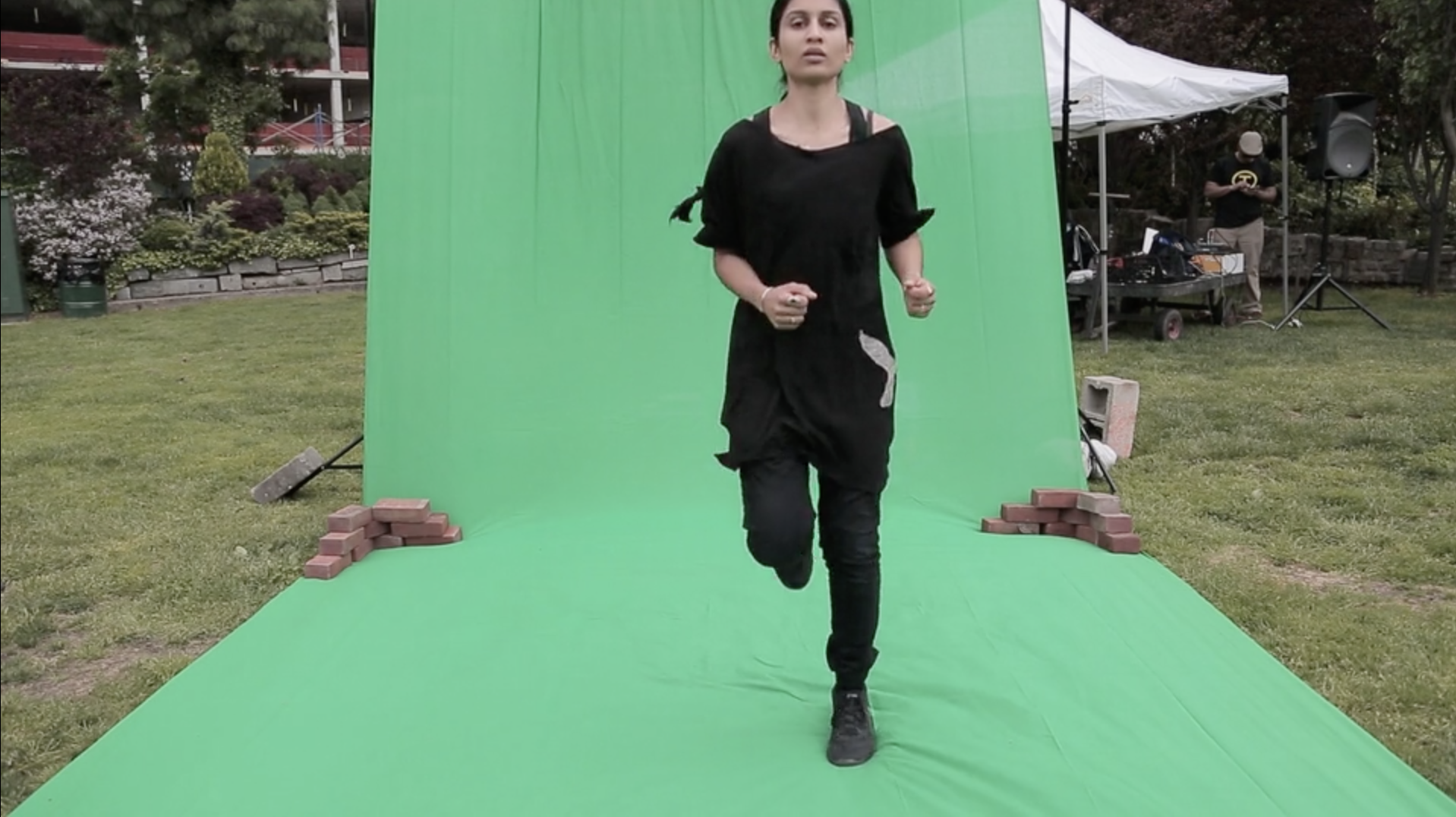 Planet Fitness,  2016  Running before a blank green screen in a NYC public park, set to a custom soundtrack mix I often use to run as a form of meditation. The soundtrack includes Sufi musician Nustrat Fateh Ali Khan, Belgium pop star Robyn, and renowned Indian vocalist Lata Mangeshkar. My ritual of resilience speaks to experiences of displacement within the United States, and more prominently in Europe. Project me where every you wish, there is a green screen provided for your leisure.  20 minute running performance set to a custom soundtrack.
