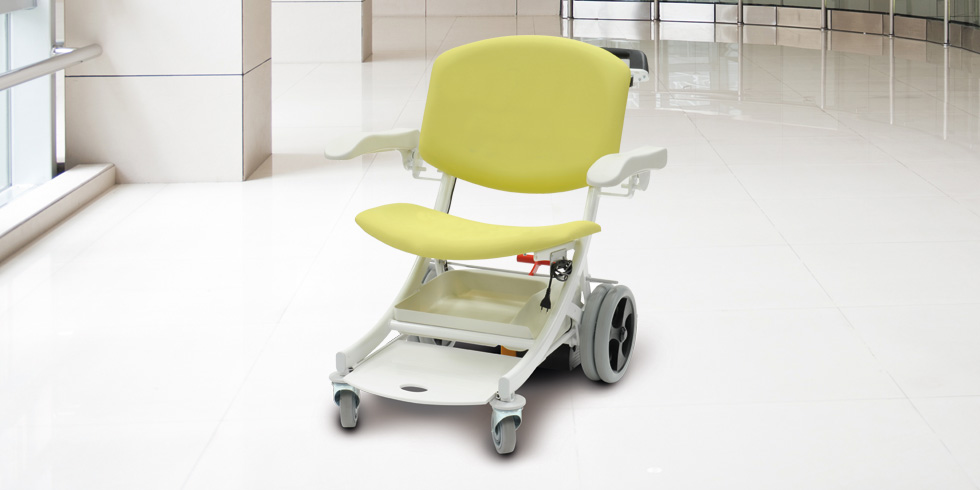 I-MOVE EZ-GO - I-MOVE EZ-GO is a transfer chair equipped with a motorised wheel, and including a built-in battery and charger. It's useful for collecting the patient and conveying him to another department, in a seated position. It is especially suited for transferring overweight patients.Click here for the online brochureClick here for more details