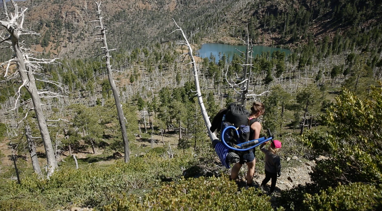 Jill Stokes hikes with her daughter Azalea to a secluded lake.