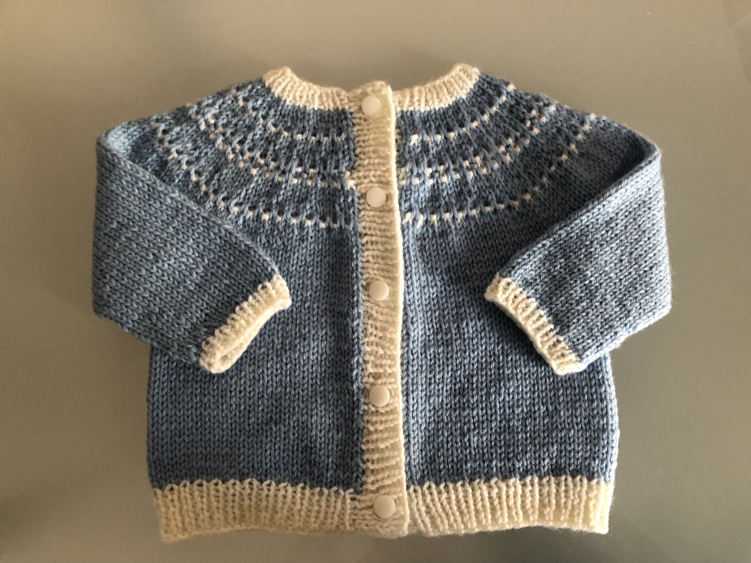 Arnica baby cardigan designed by  Orlane Sucche , knit by me in January 2019.