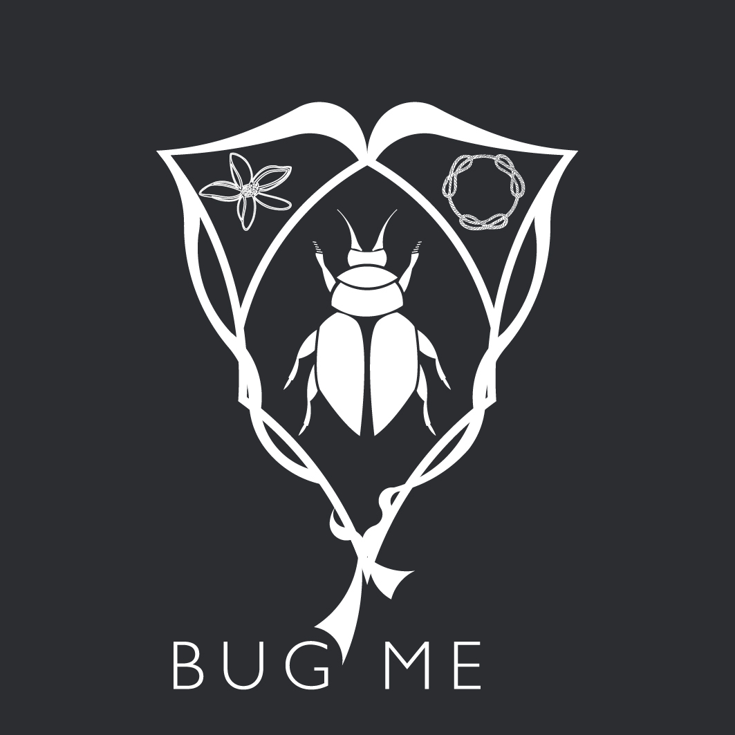 The Bug Me Studio GmbH - A laboratory of ideas - The Bug Me brand icon, the shield, represents unity in work, symbolised by the braided cord, with the three inseparable needles - like the osmosis between the two creative founders. The orange blossom reveals the beauty in the arts and the craftmanship, a strong point for Bug Me.