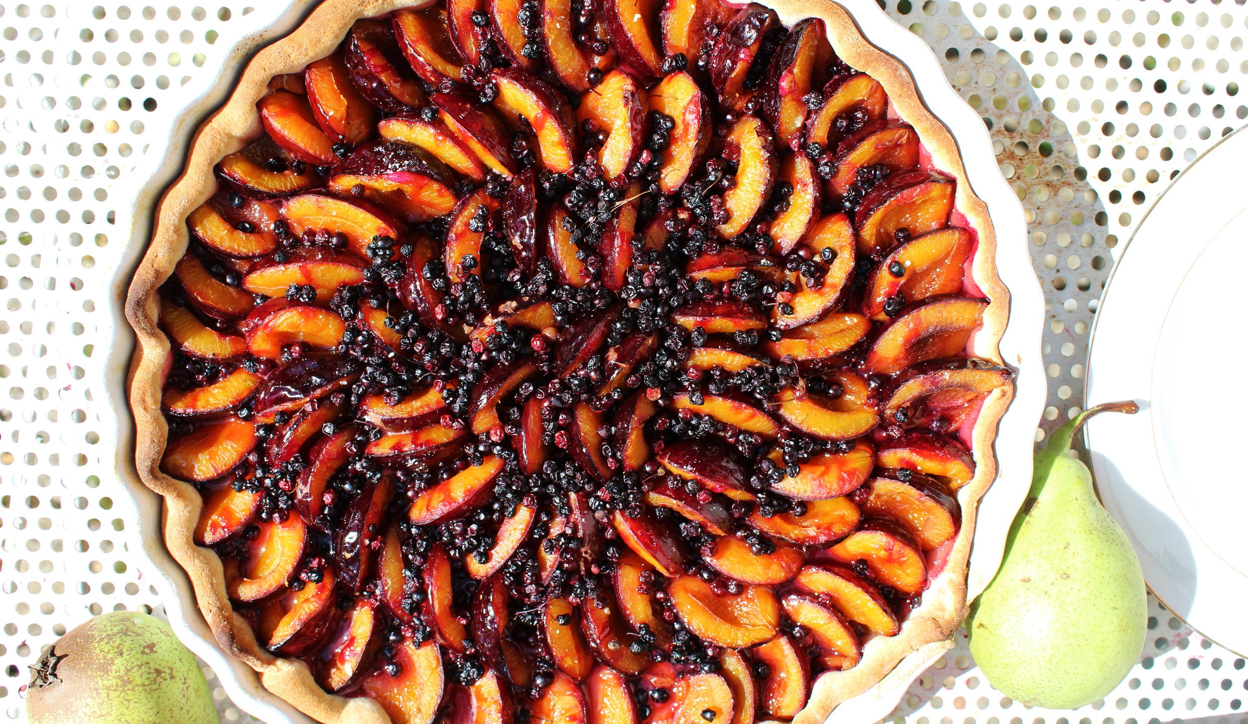 Recipe of my quetsch tart - First of all, preheat oven 180° C/ 350 FIngredient list:- 800gr of tasty quetsch plums- half a tea spoon of cinnamon- a pinch of crushed red Cayenne pepper- 3 spoons of organic honey limeTo make the dough you need- 100gr of soft butter- 50gr of powdered almond- 1 egg- 190 gr of white organic flour- 80 gr of icing sugar