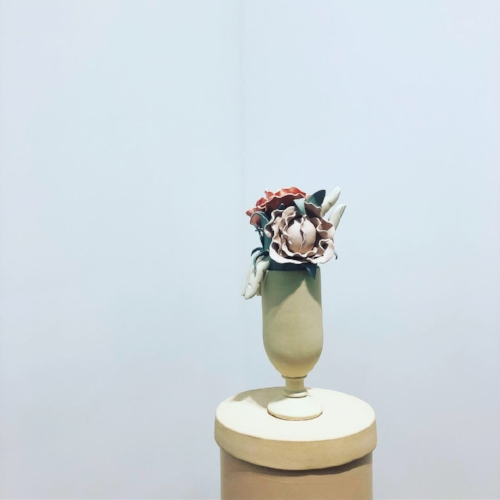 Genesis Bellanger's surreal sculpture (yes, that is a finger peeking out from this bouquet) at Perrotin