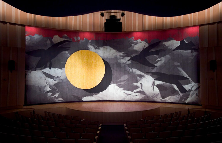 Handwoven theater curtain depicting four ravens and the Moon along with images of a winter night of ice and mist in the Smithsonian's National Museum of the American Indian, Washington, DC.