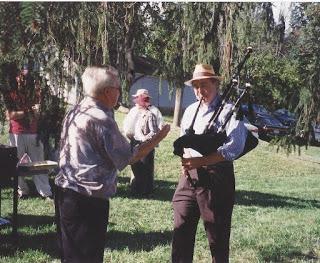 "Mo. Fricke ""conducting"" Steve Bates on bagpipes"