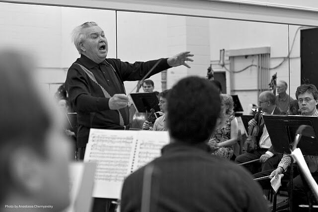 Maestro Fricke rehearses the orchestra and singers. Photo Credit: Anastasia Chernyavsky
