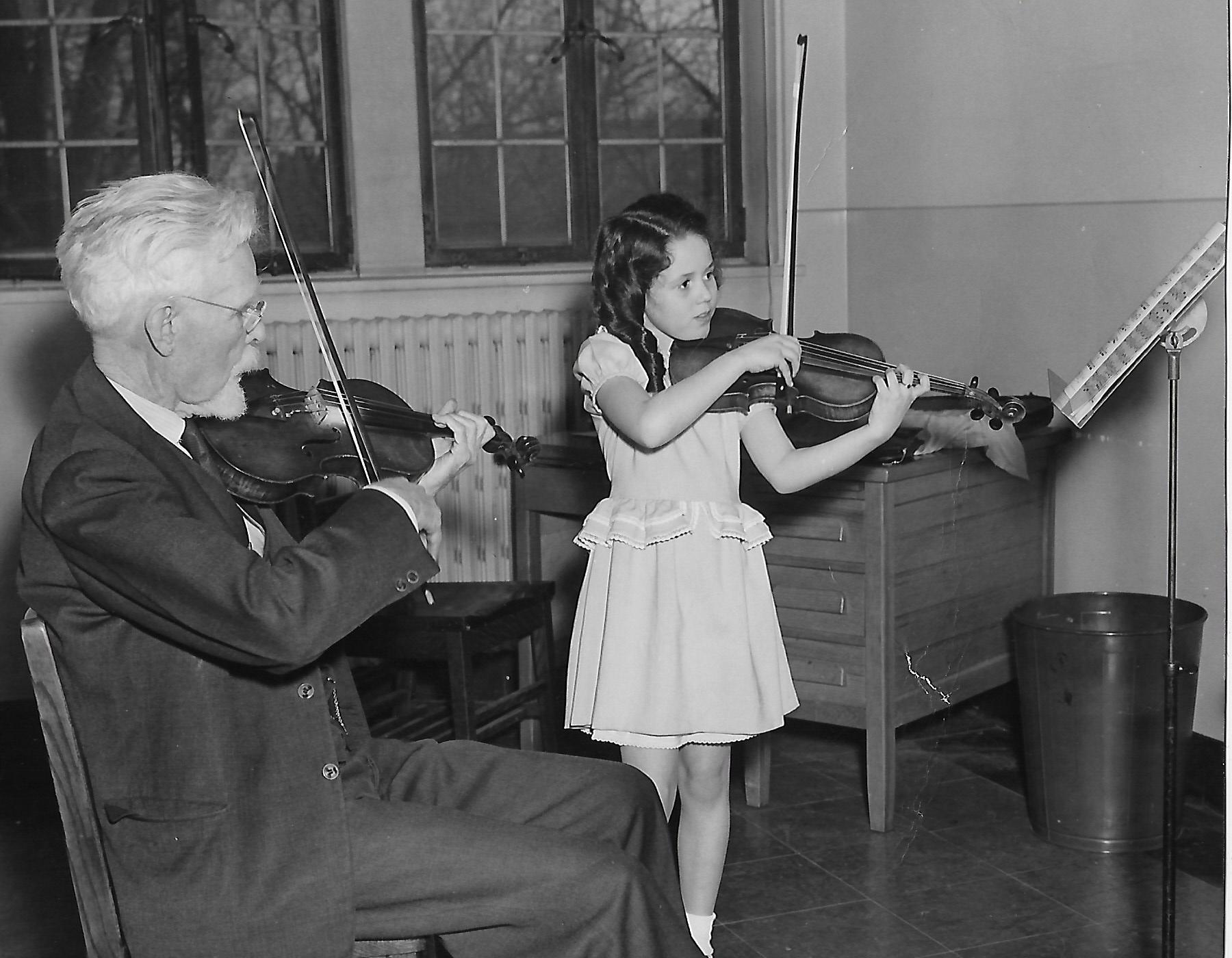 Meg with F. Schaefer (first violin teacher, Meg 8 yrs old; Dr. Schaefer 83 yrs old)