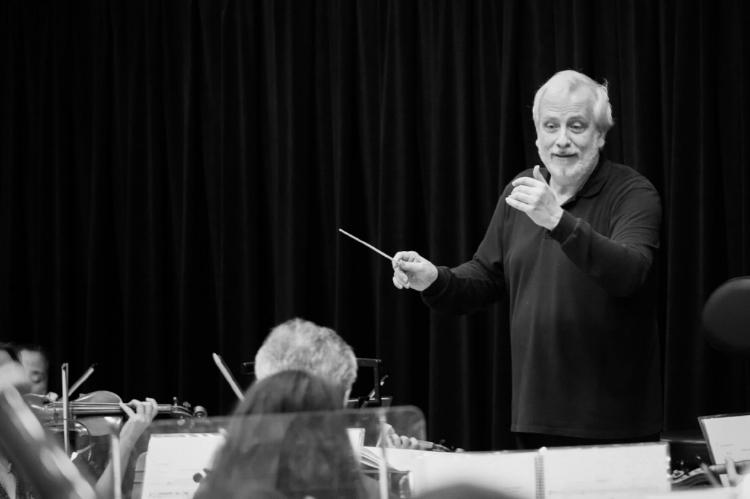 Auguin rehearsing the orchestra for Verdi's Don Carlo